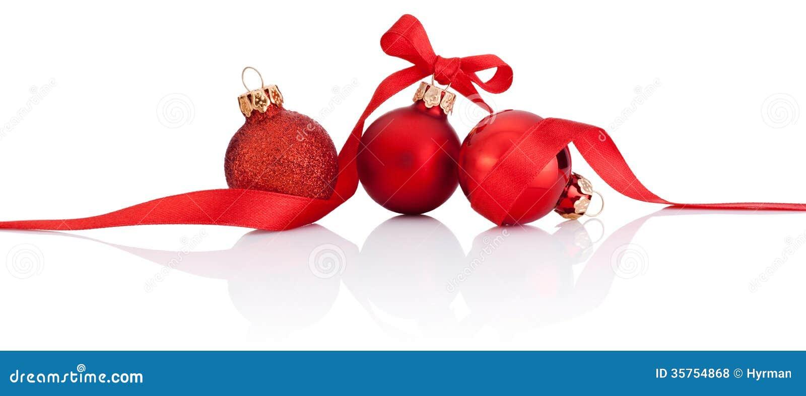 Trois boules rouges de no l avec l 39 arc de ruban d for Decoration de noel exterieur avec ruban