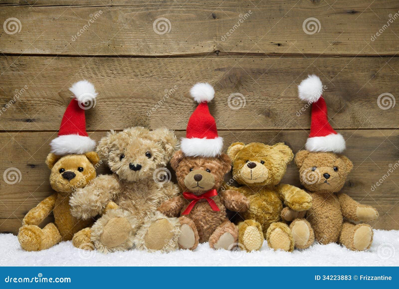 Trois ours de nounours avec des chapeaux de no l sur le fond en bois photos stock image 34223883 - Nounours noel ...