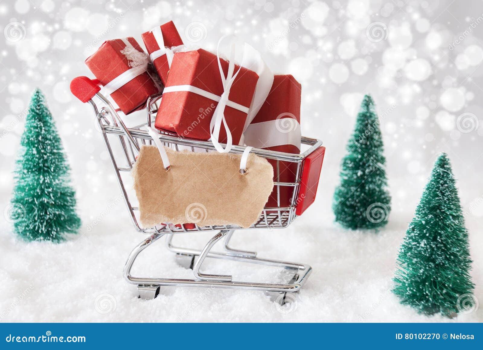 Trole com presentes do Natal e neve, espaço da cópia