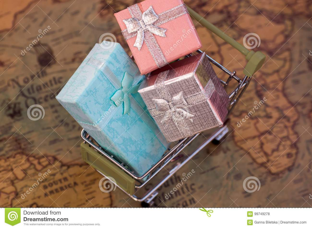 A trolley with gift boxes on the world map delivery stock photo download a trolley with gift boxes on the world map delivery stock photo image gumiabroncs Gallery