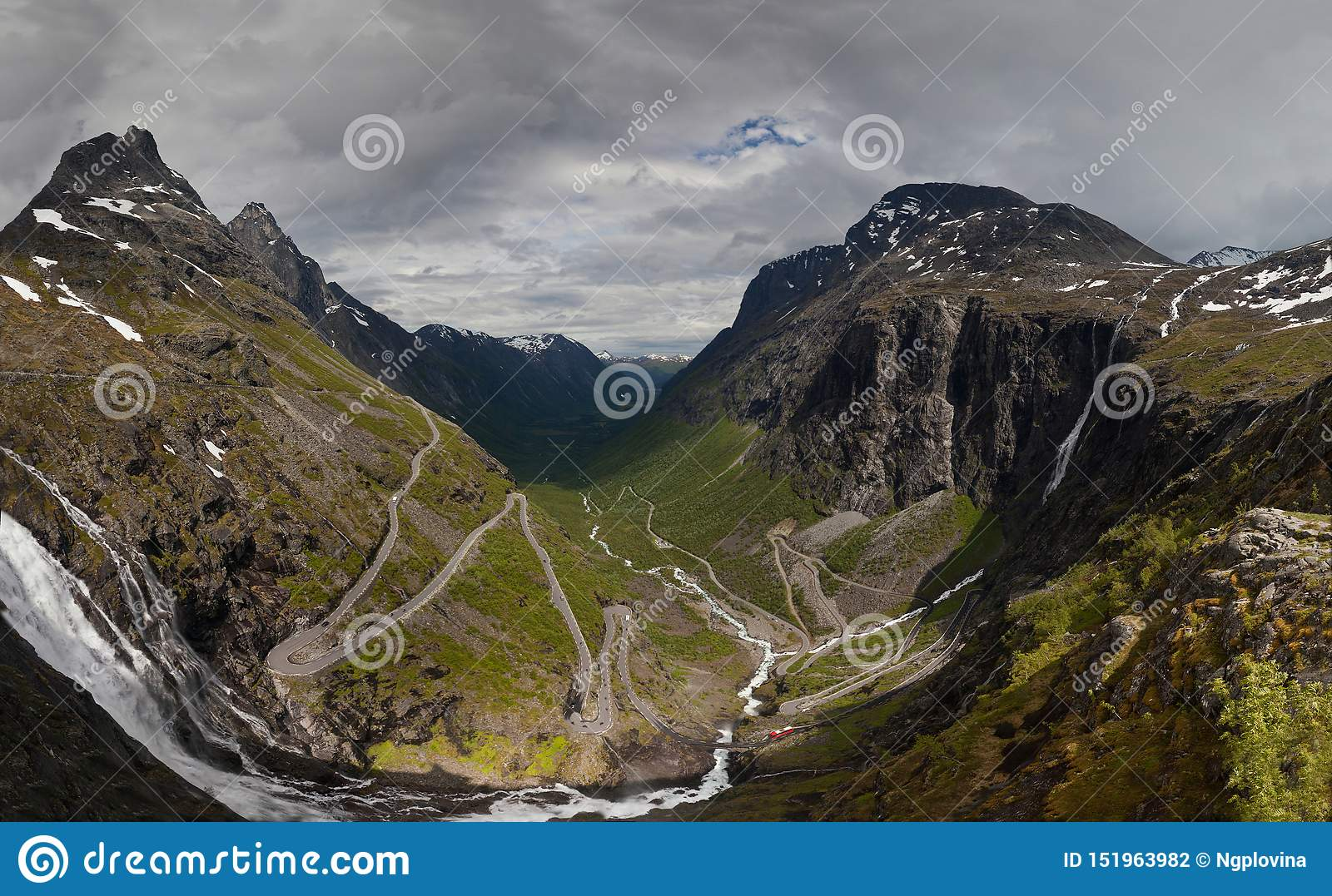 Trollstigen road. The panorama of world famous curvy road of Trollstigen with abrupt turns with a cloudy sunny sky on