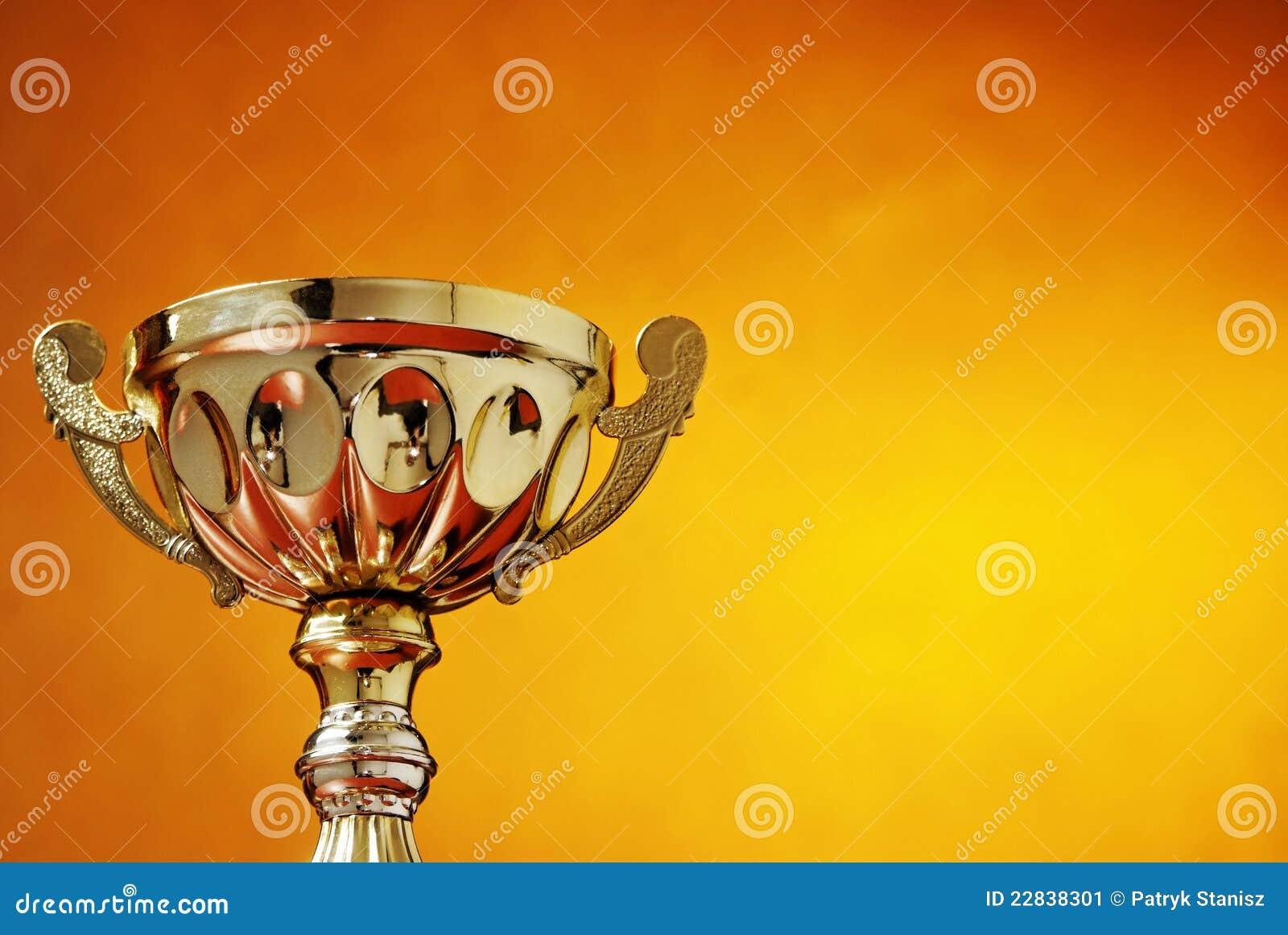 Trophy cup on orange background