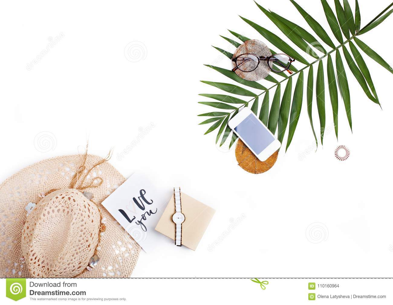 Tropic palm leaf, straw hat, glasses and handwritten card `love