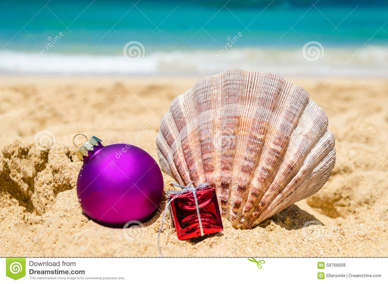 merry christmas and happy new year background with seashell gift and a ball on the tropical beach near ocean in hawaii - Merry Christmas In Hawaii