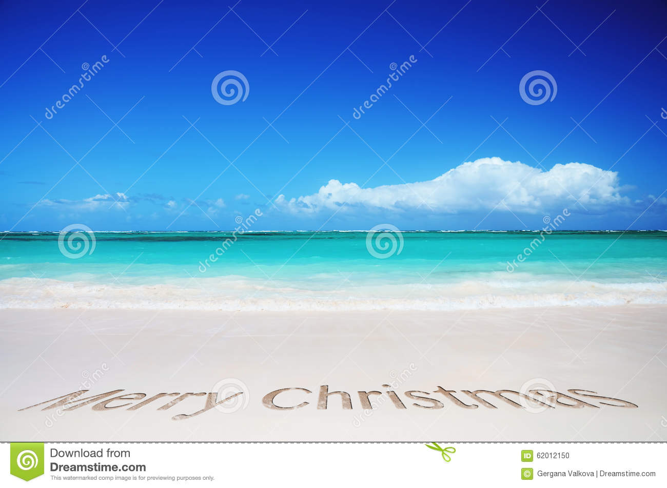 tropical beach and merry christmas text stock photo - Merry Christmas Beach Images