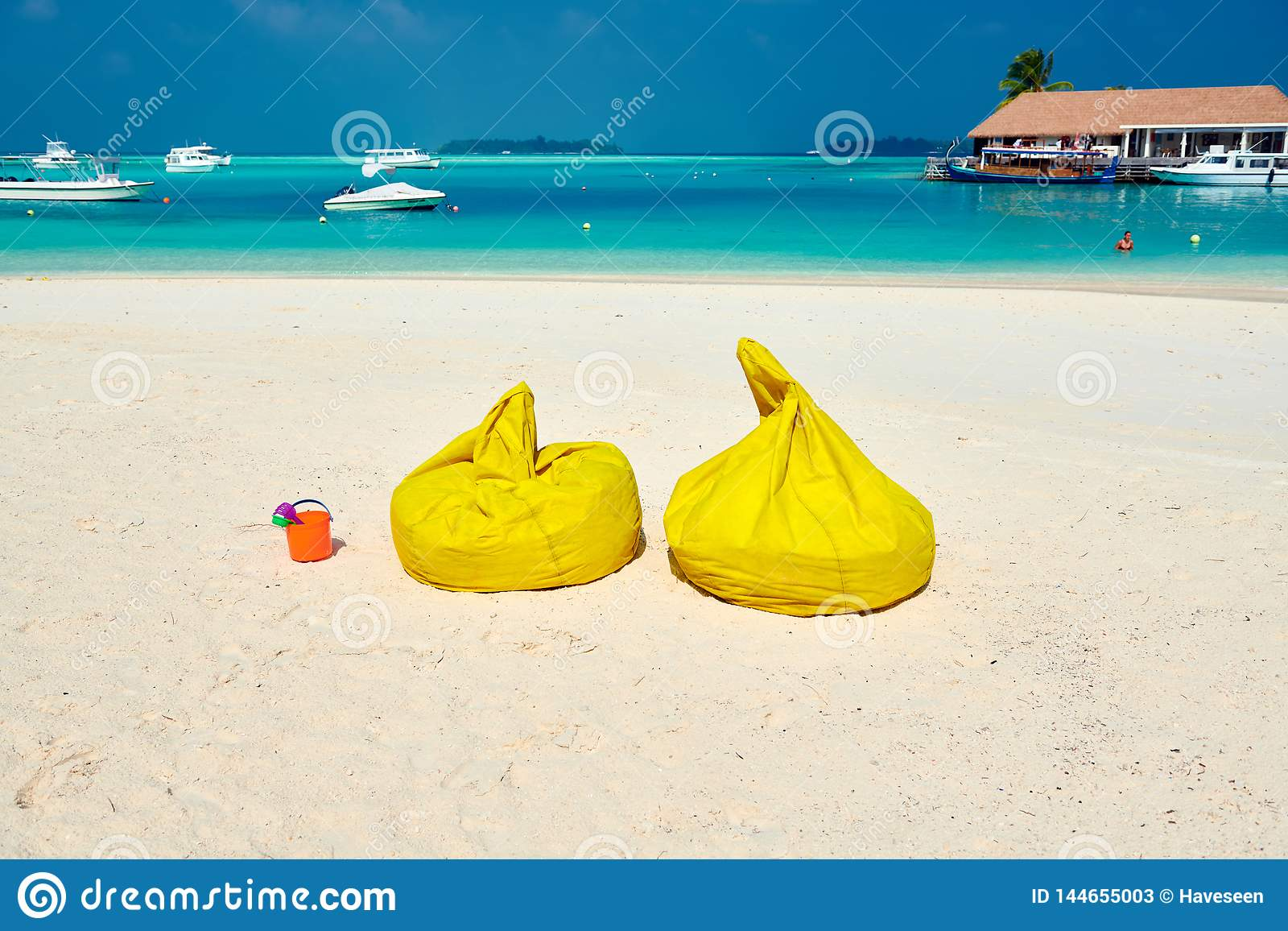 Peachy Tropical Beach With Yellow Beanbag Chairs Stock Image Alphanode Cool Chair Designs And Ideas Alphanodeonline