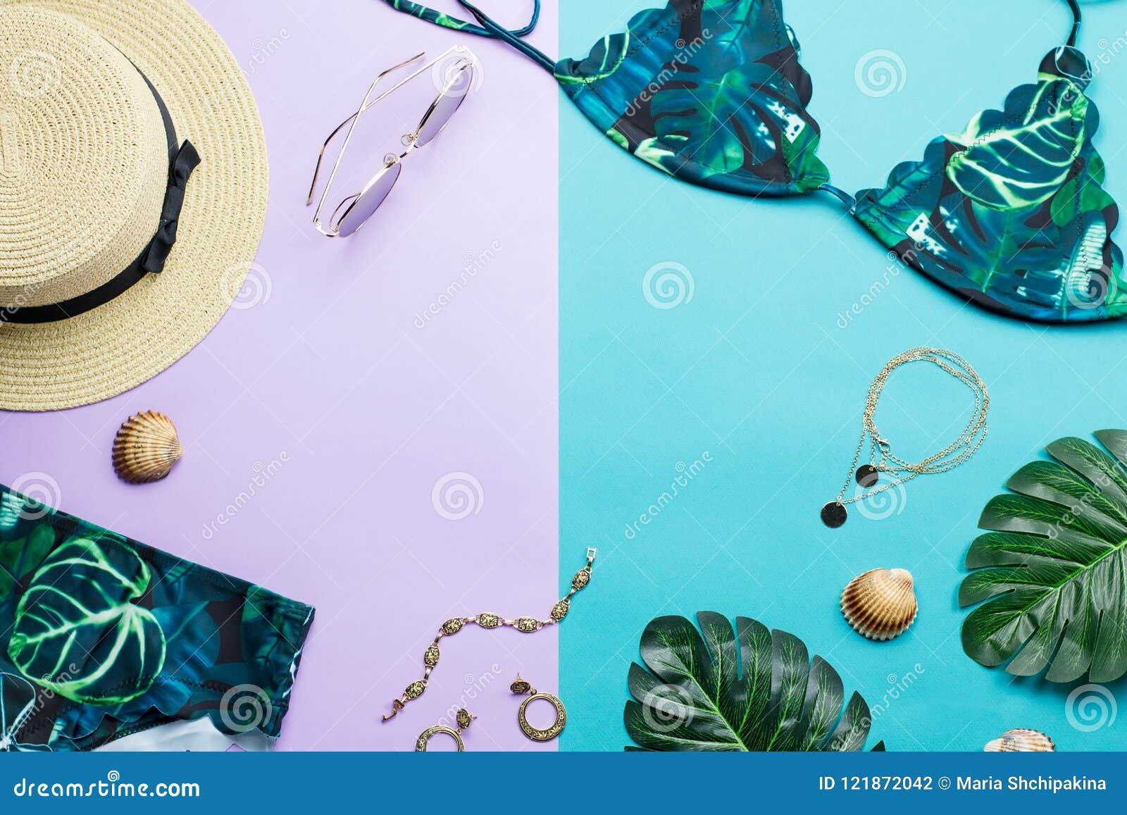 edd842fd Tropical bikini swimsuit, beach fashion. Traveler woman accessories flat lay  with swimwear, palm leaves.