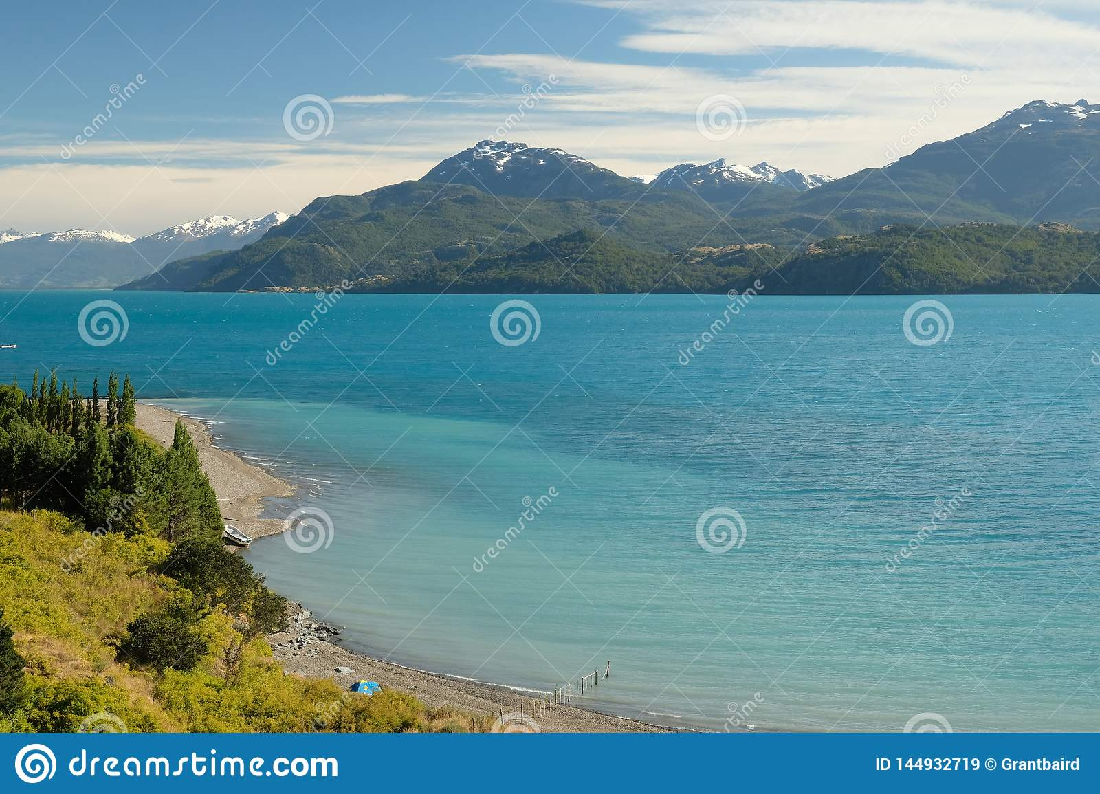 Tropical blue lake General Carrera, Chile with landscape mountains and tent