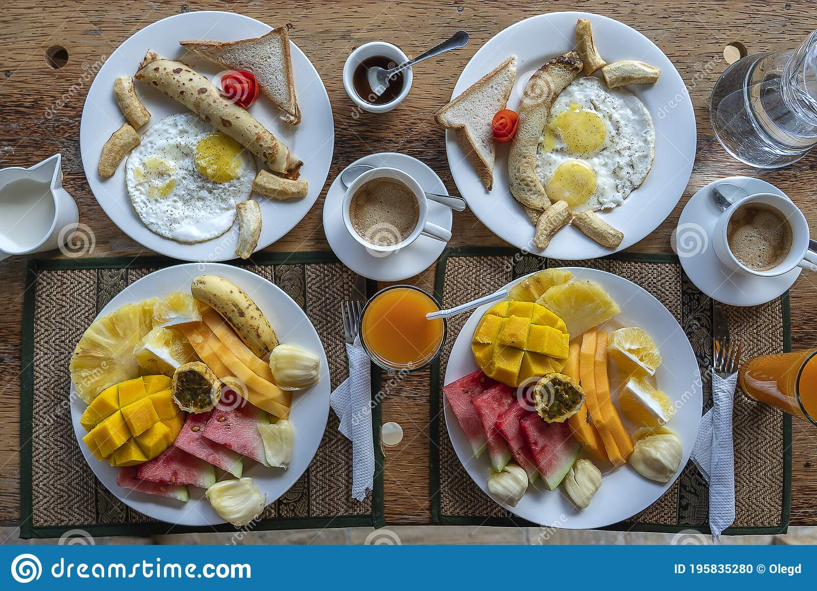 Tropical Breakfast Of Fruit Coffee And Scrambled Eggs And Banana Pancake For Two On The Beach Near Sea Stock Photo Image Of Diet Exotic 195835280