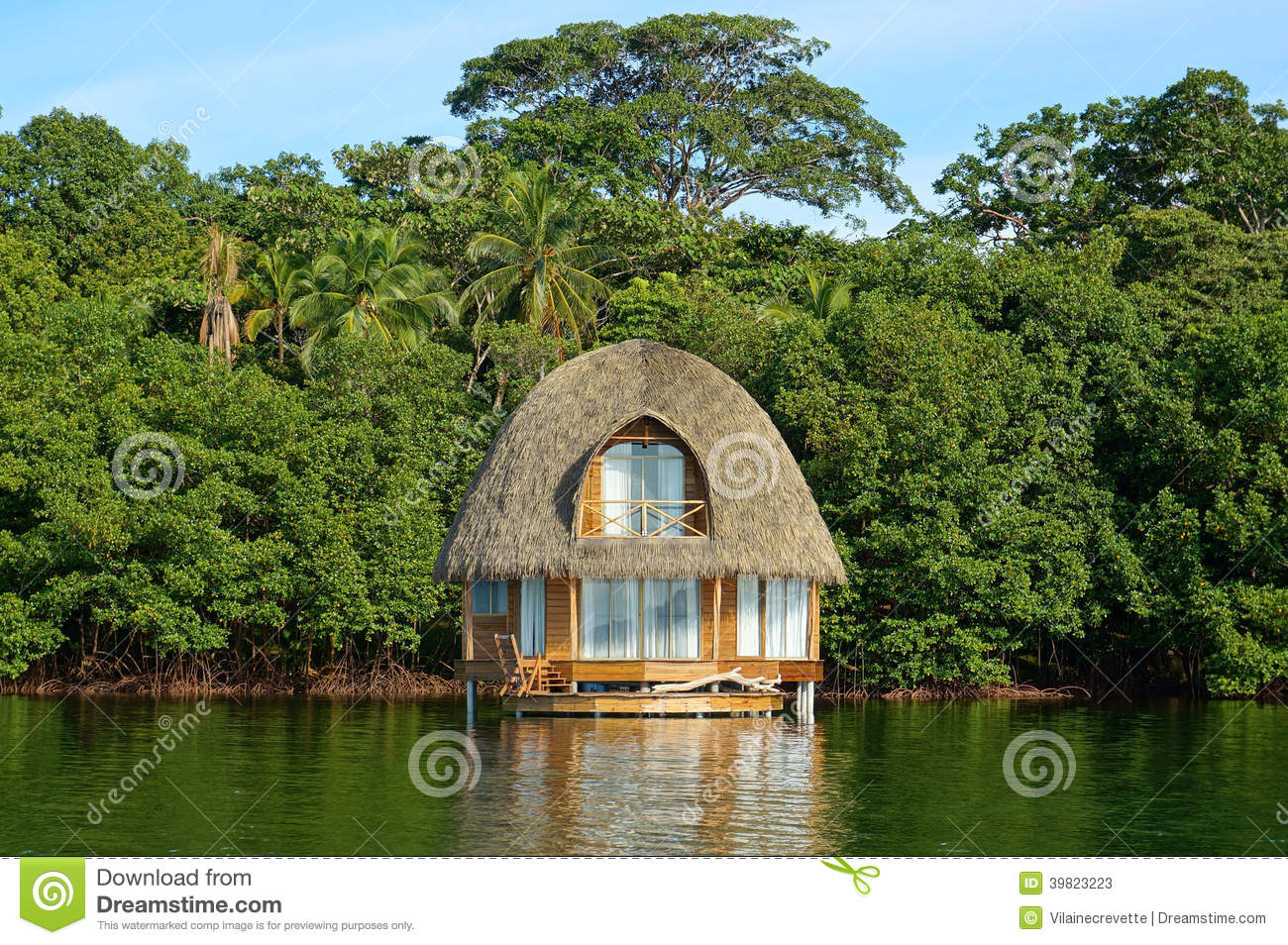Tropical Bungalow Over Water Thatched Roof Stock Image