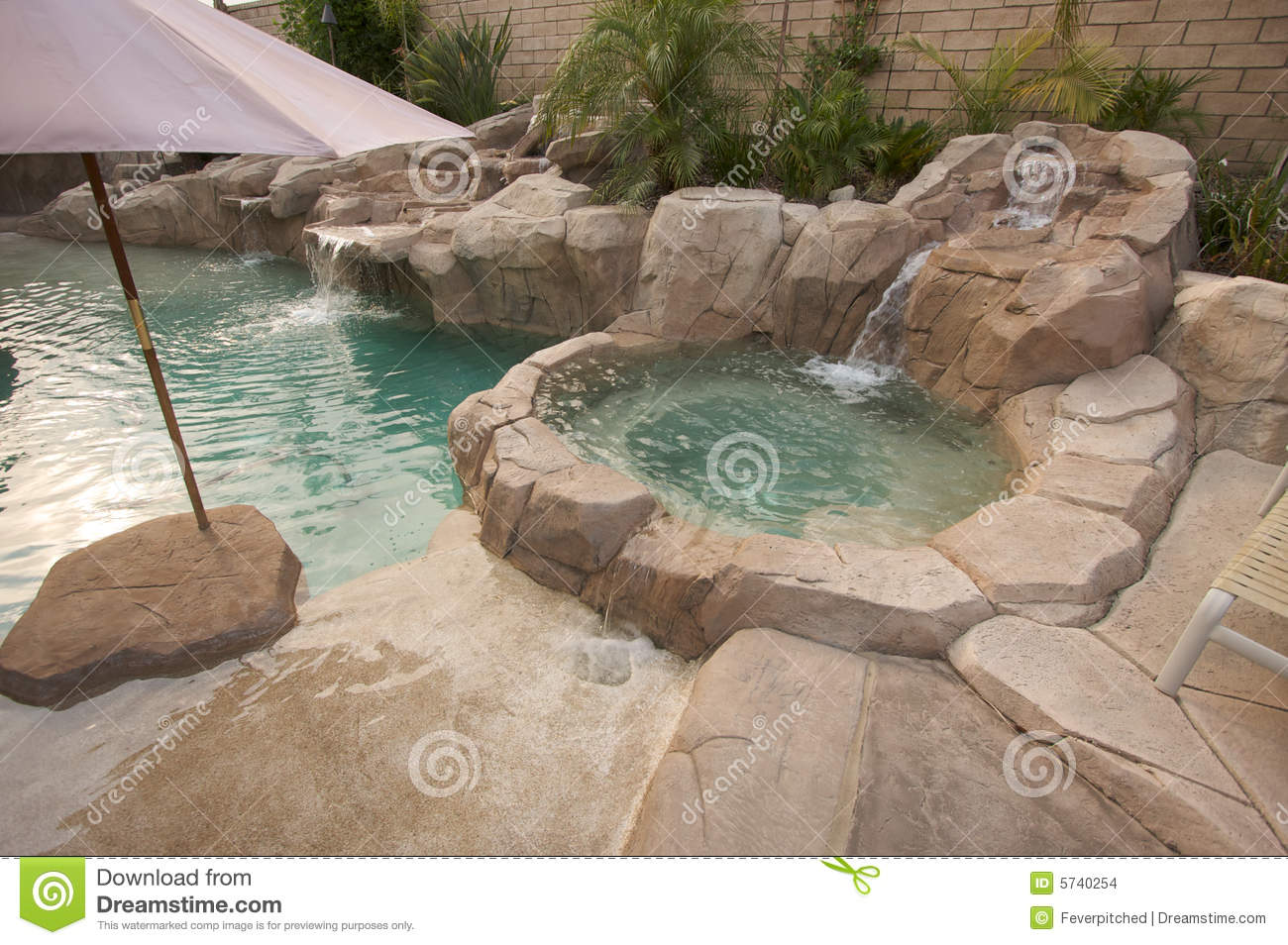 tropical custom pool jacuzzi stock photo image of stone jacuzzi 5740254. Black Bedroom Furniture Sets. Home Design Ideas