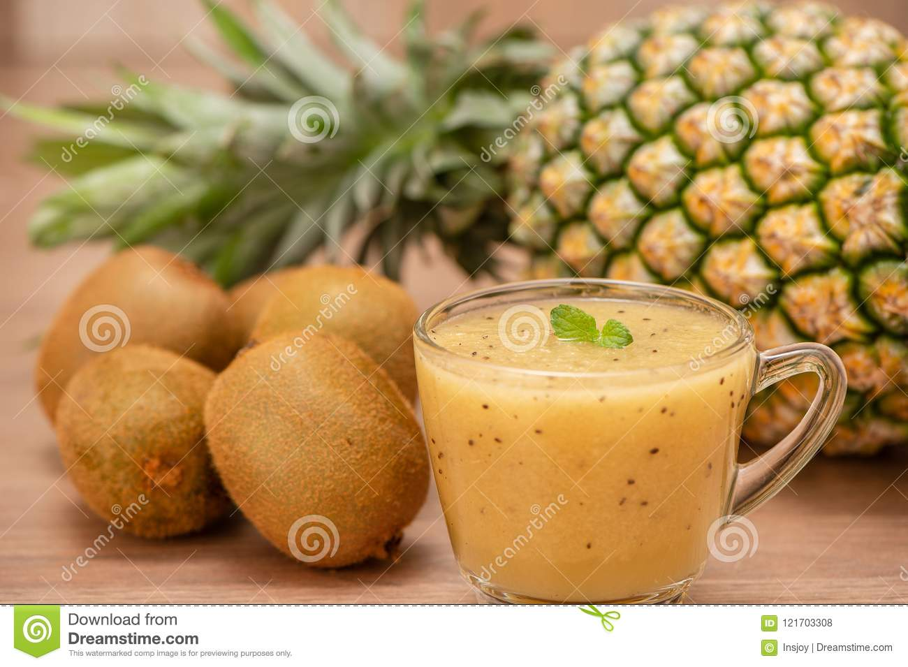 Tropical fresh fruit set and juice smoothies isolated with wooden background