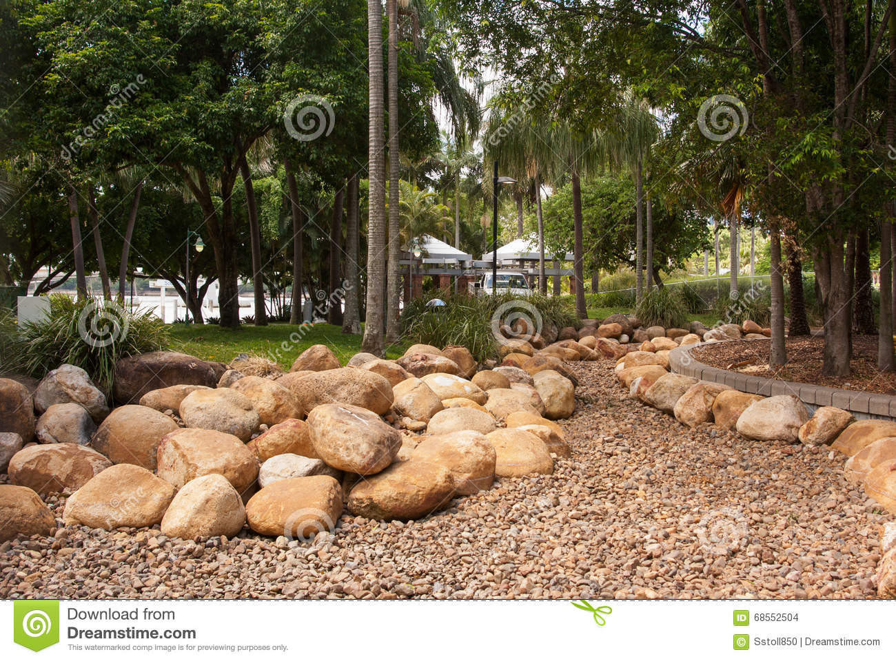 Tropical Garden With Palms And Rocks Stock Photo - Image of drainage ...