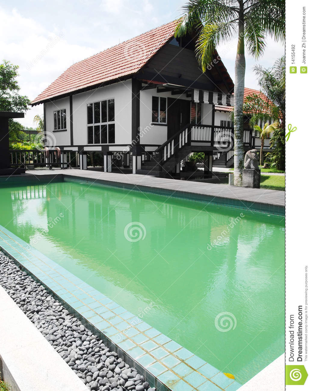 tropical house and swimming pool stock photo image of hotelsa photograph of a traditional style tropical house with beautiful landscaped gardens and green swimming pool in the yard tropical style architecture of