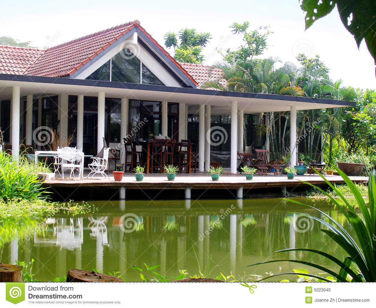Tropical house veranda natural pond stock photo image for Homes with verandahs all around