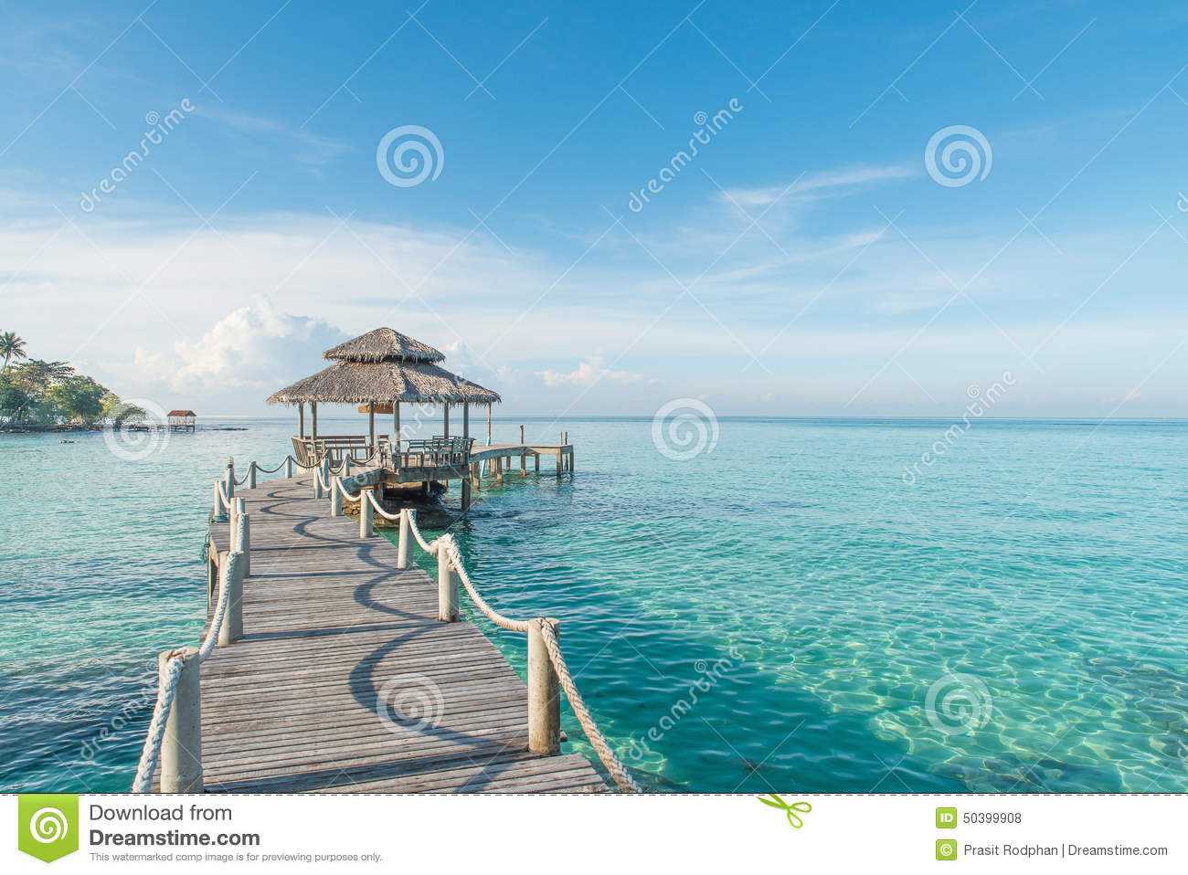 Tropical hut and wooden bridge at holiday resort. Summer travel