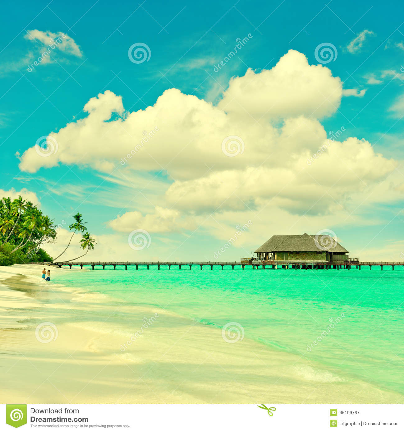 Tropical Island Beach With Turqiuse Water And Blue Sky