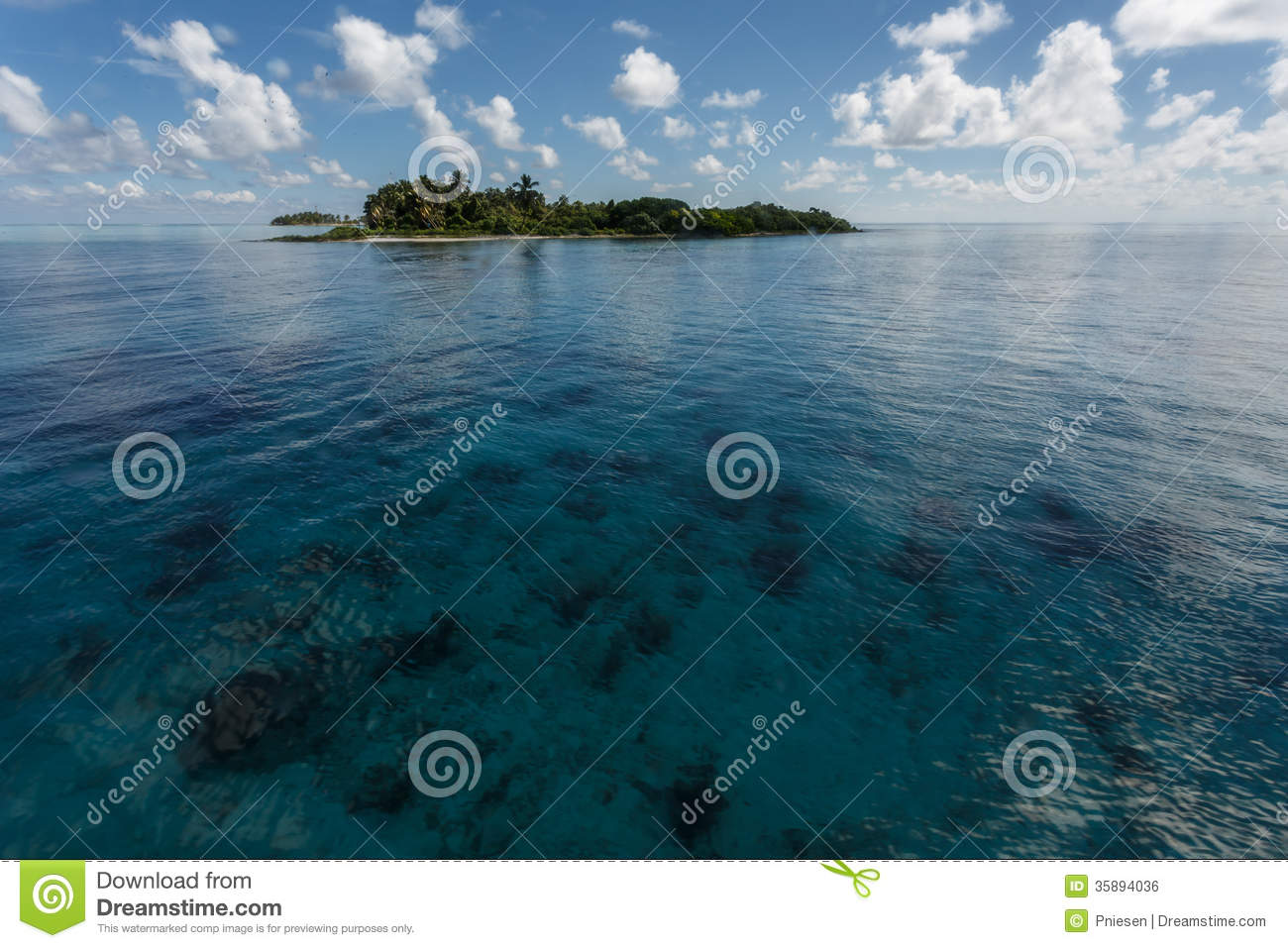 Tropical island rises above coral reef in Hol Chan Marine Reserve Belize