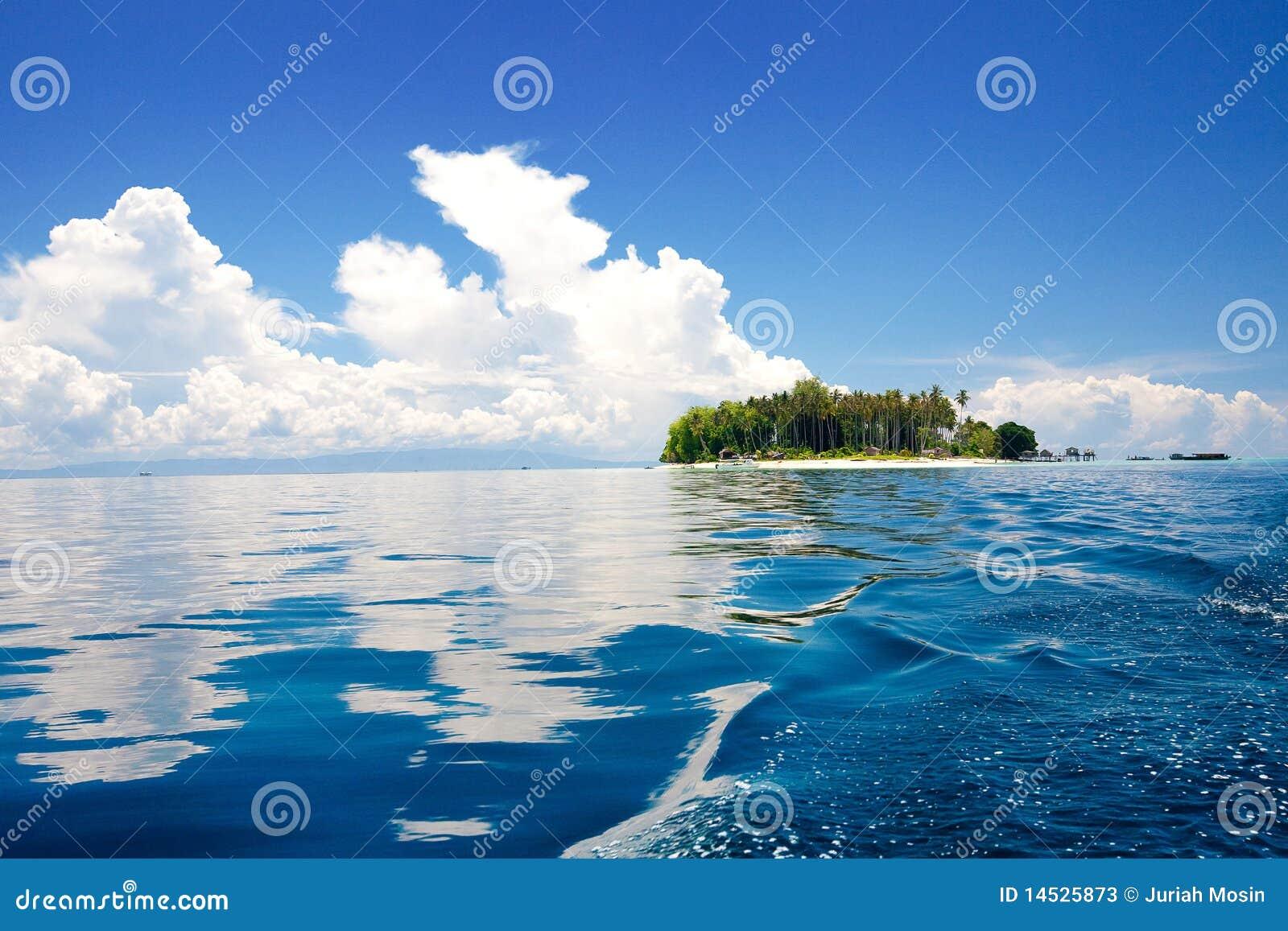 Tropical Island Sun: Tropical Island In The Sun With Blue Skies Stock Photos