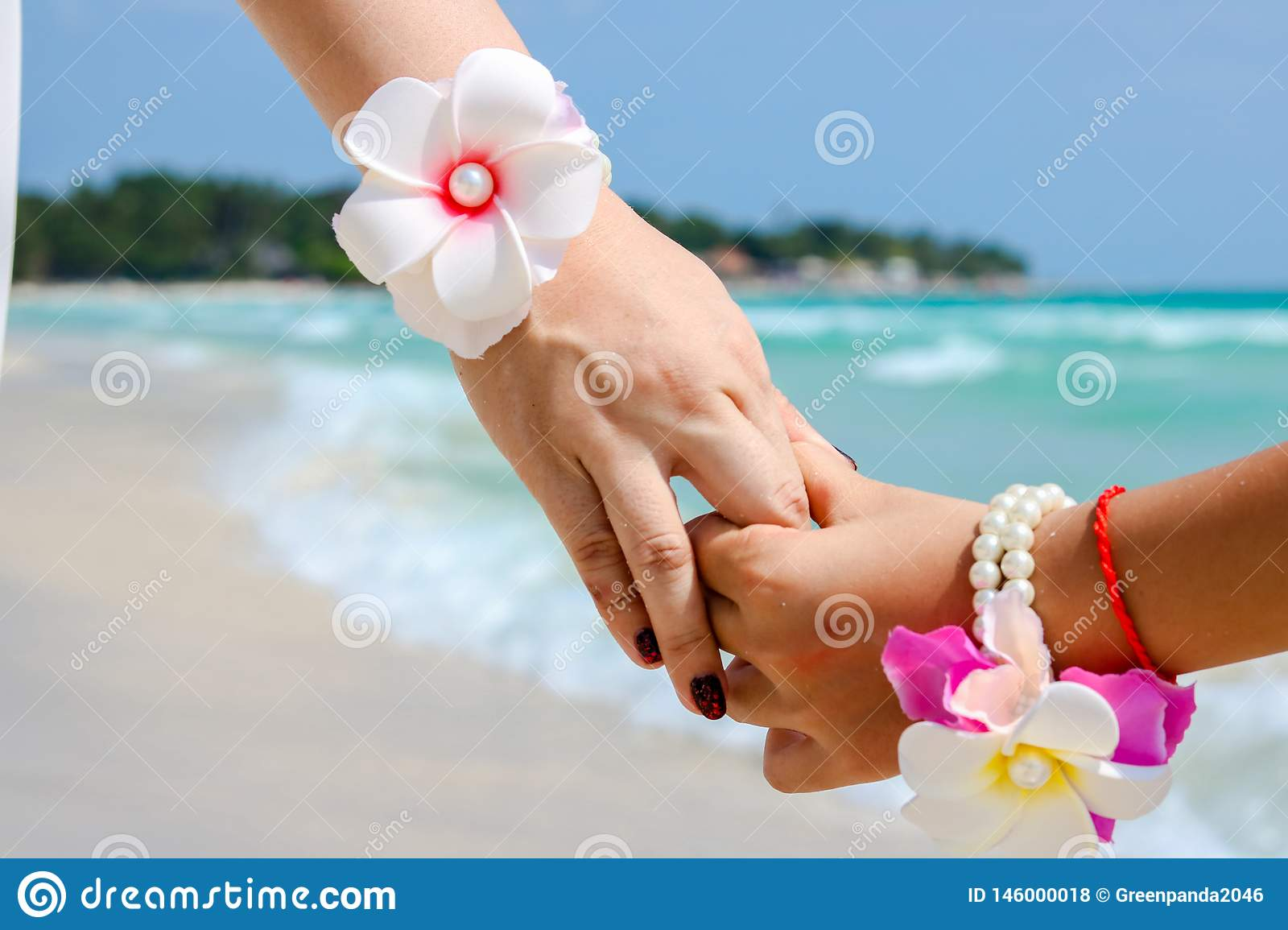 Beautiful young couple hand in hand