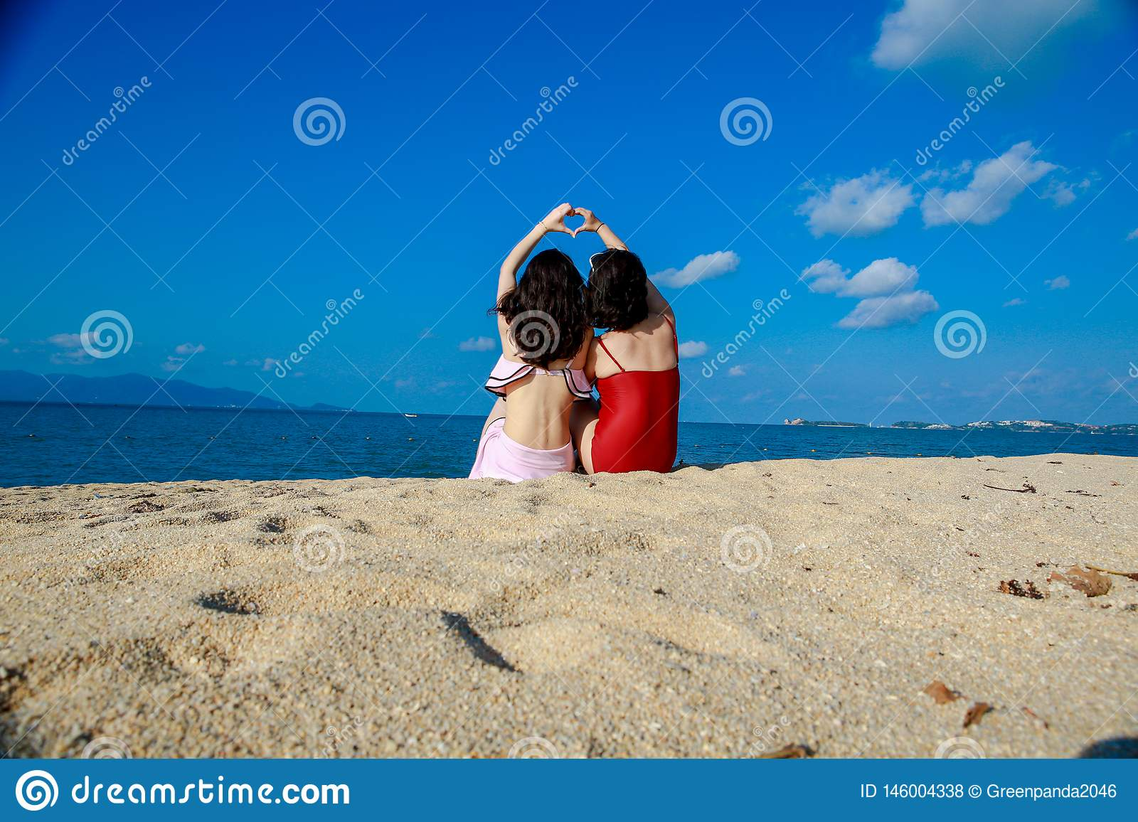 Happy girls on the beach-good friend