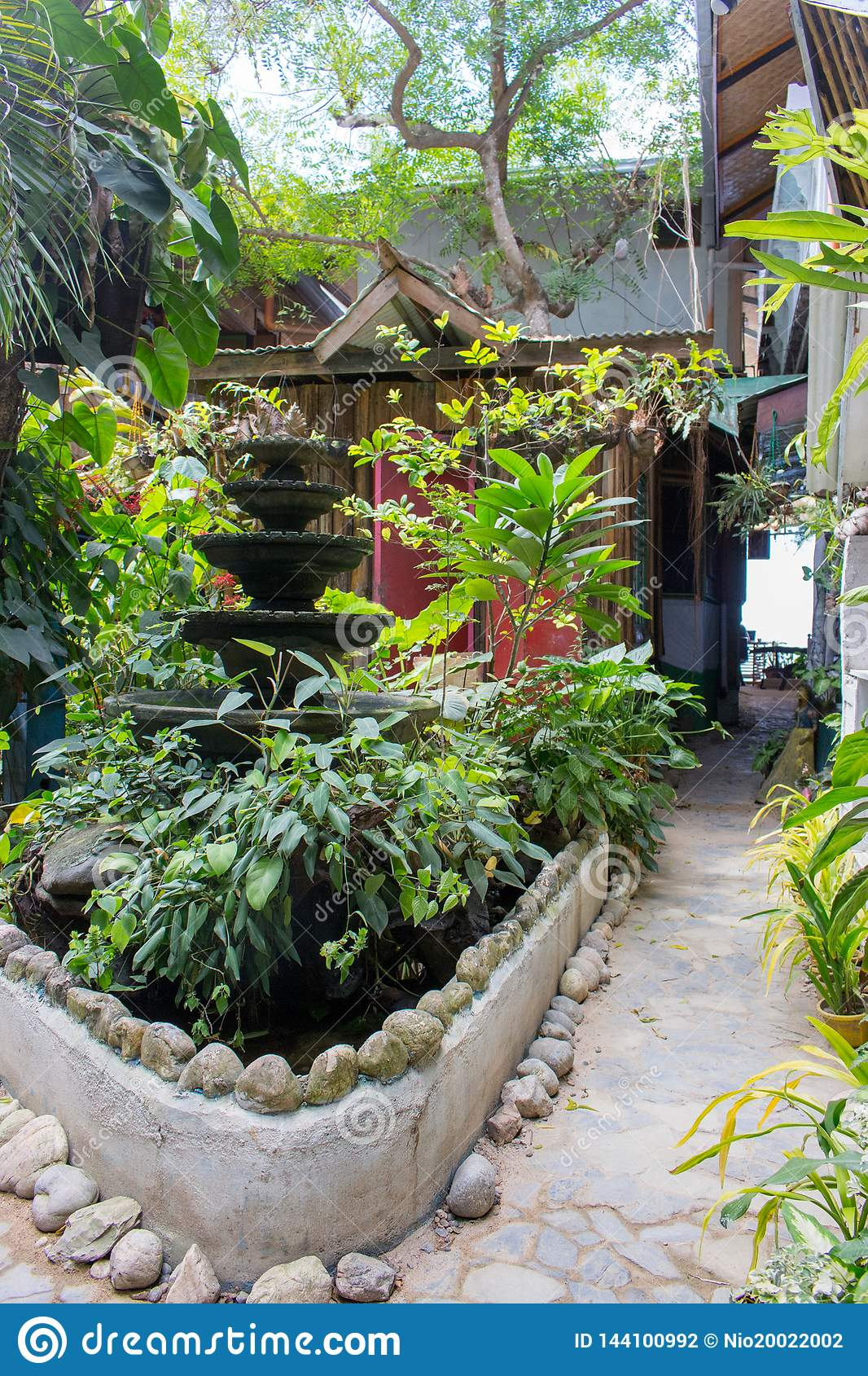 Patio With Plants Flower Pots Trees And Small Fontain Beautiful Backyard In Asian Village Philippines Gardering Concept Stock Photo Image Of Terrace Village 144100992