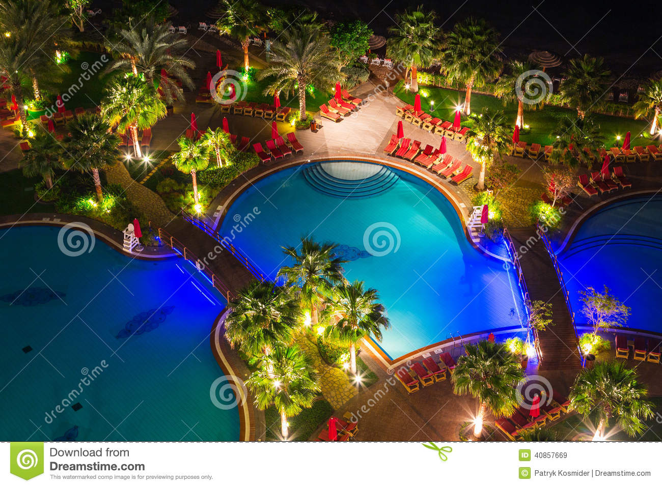 Tropical Pool Area At Night Editorial Stock Image