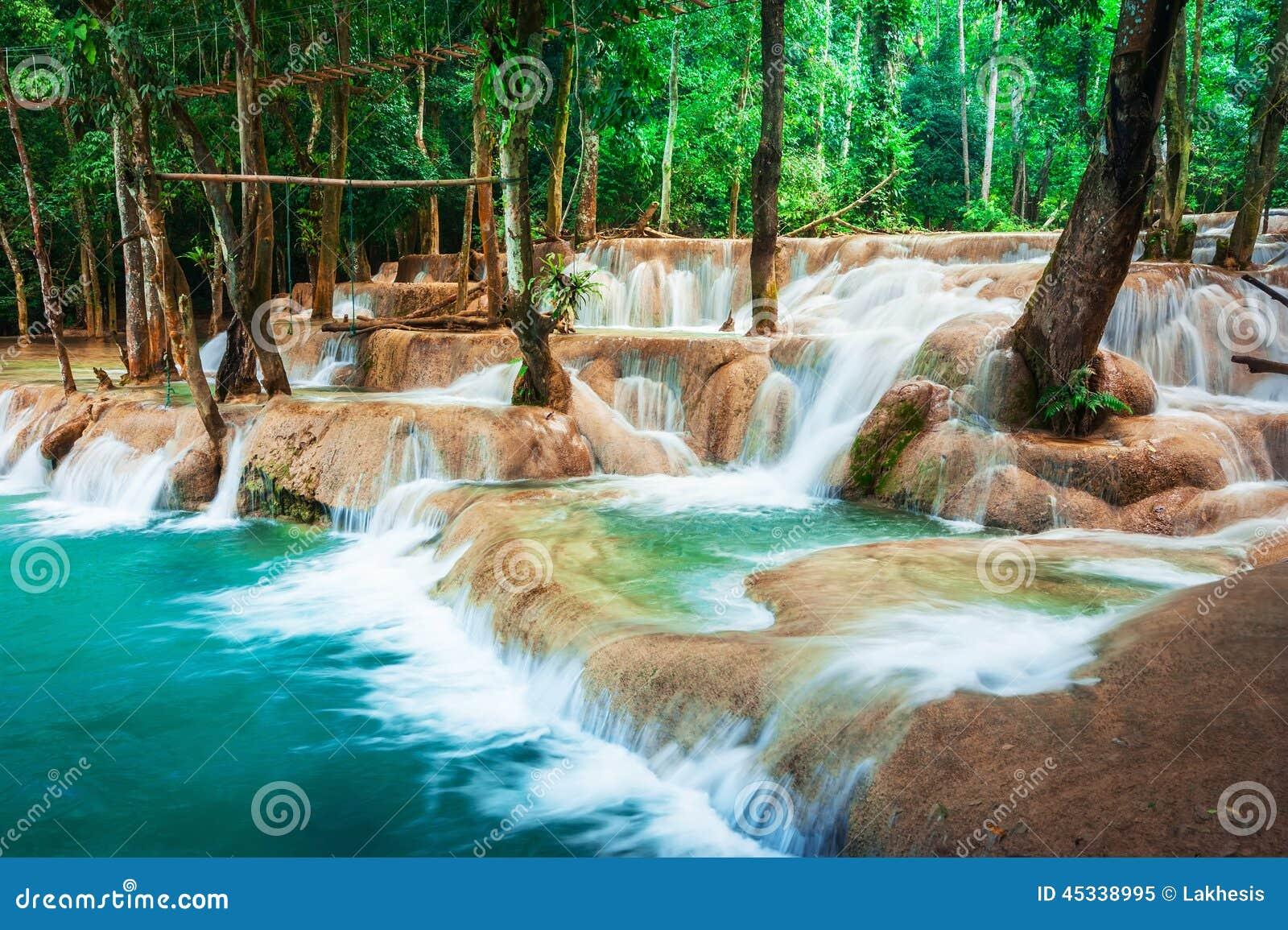 Tropical rain forest with Kuang Si cascade waterfall. Luang Prabang, Laos