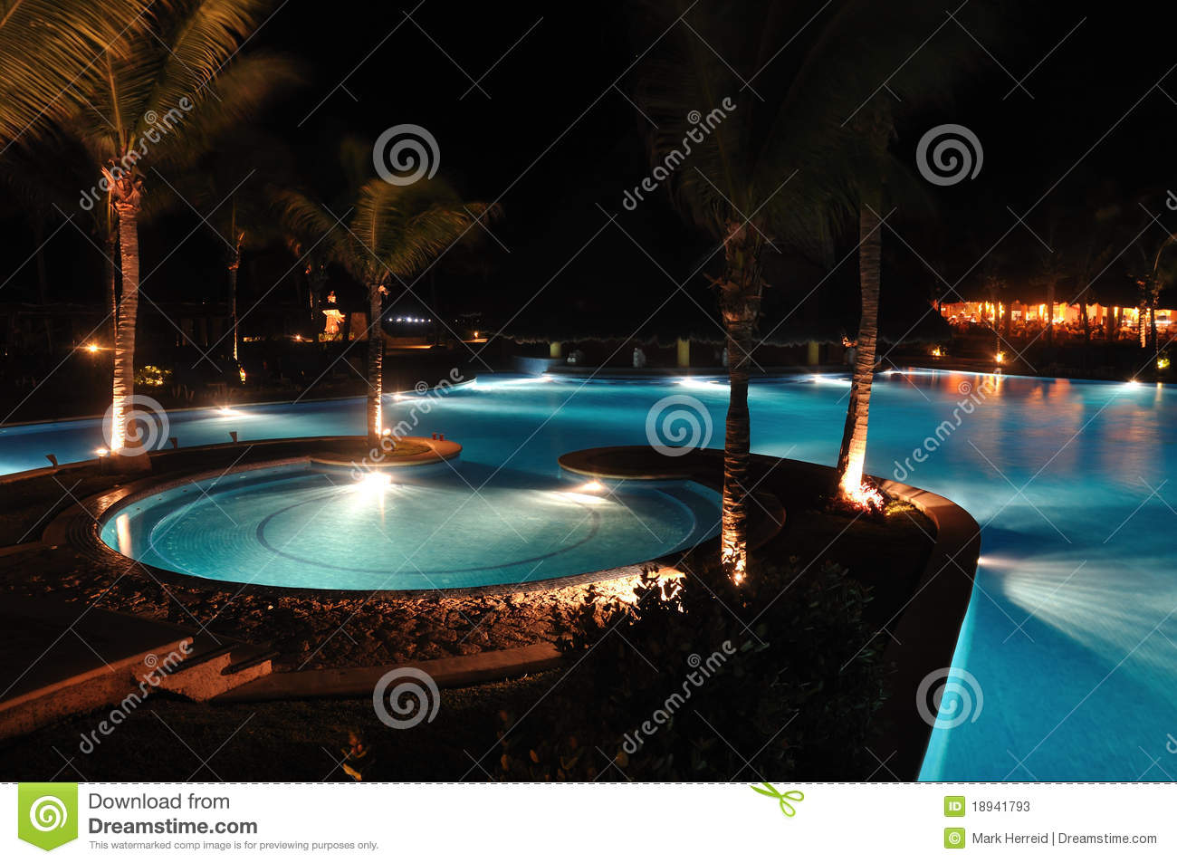 Tropical Resort Swimming Pool At Night Stock Photos
