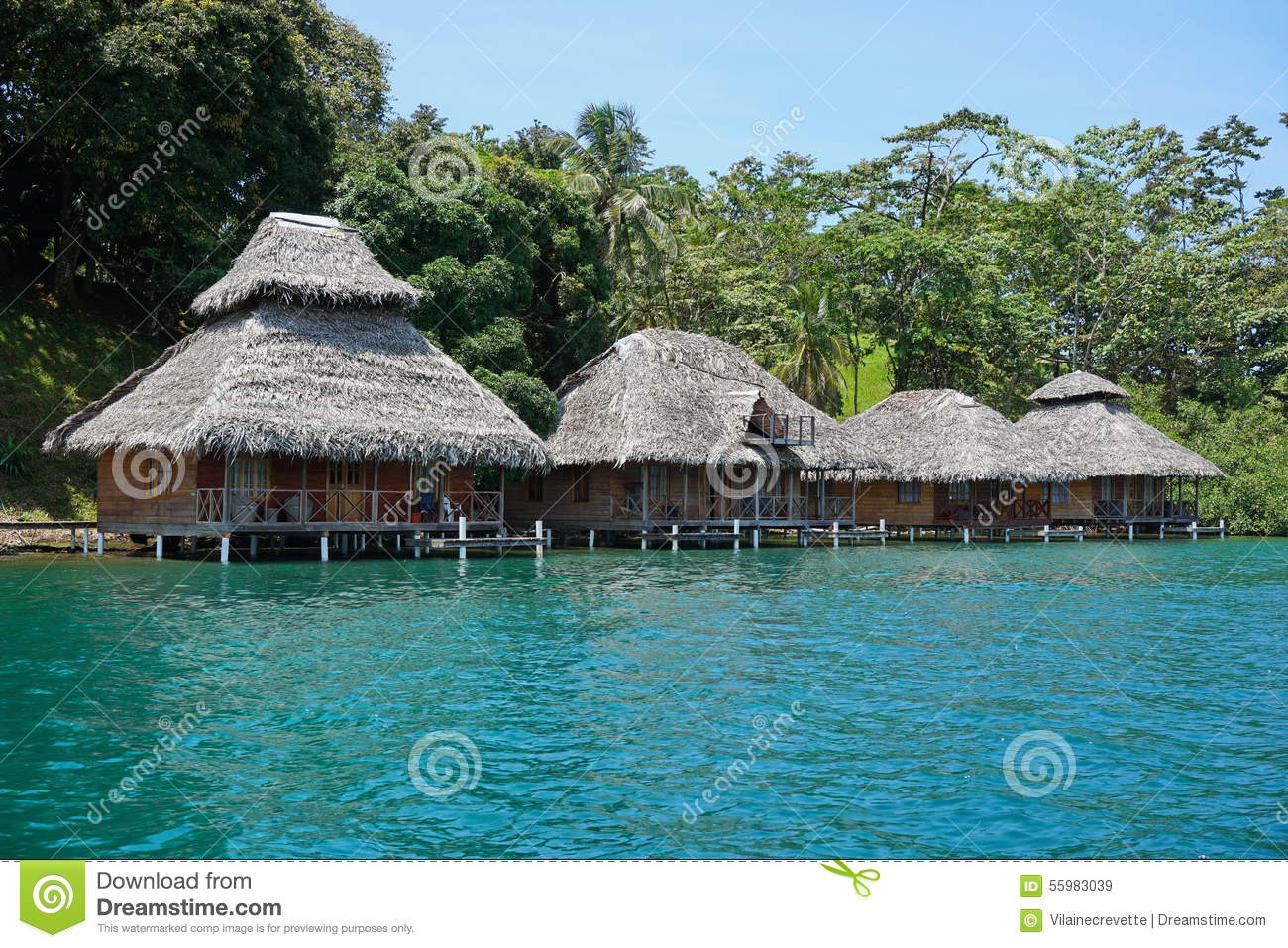 Tropical Resort With Thatched Bungalows Over Water Stock Photo - Image ...