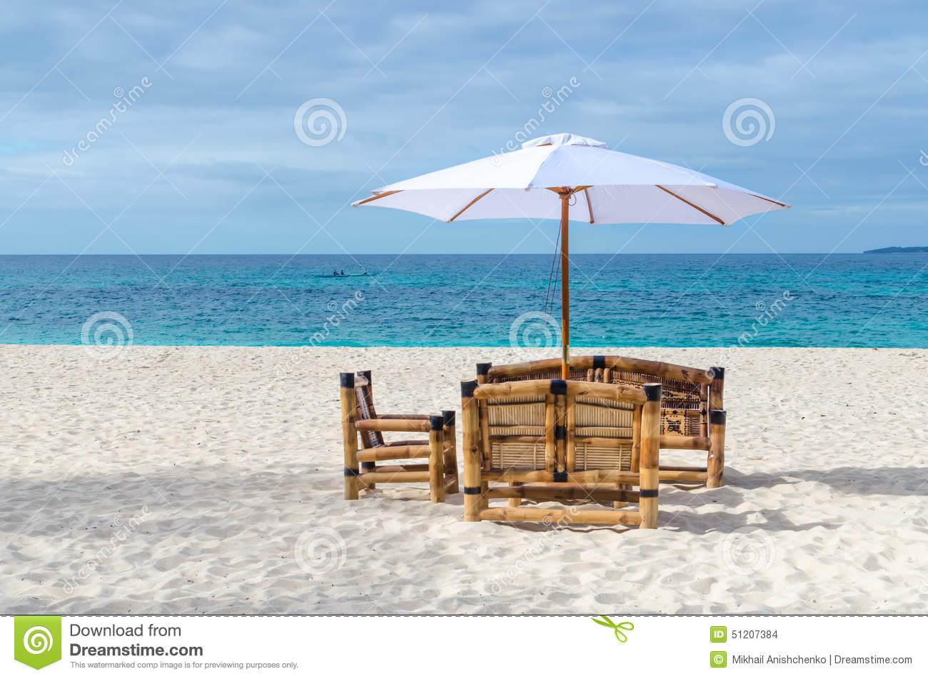 Tropical Resort View With Beach Table, Chairs And Umbrella