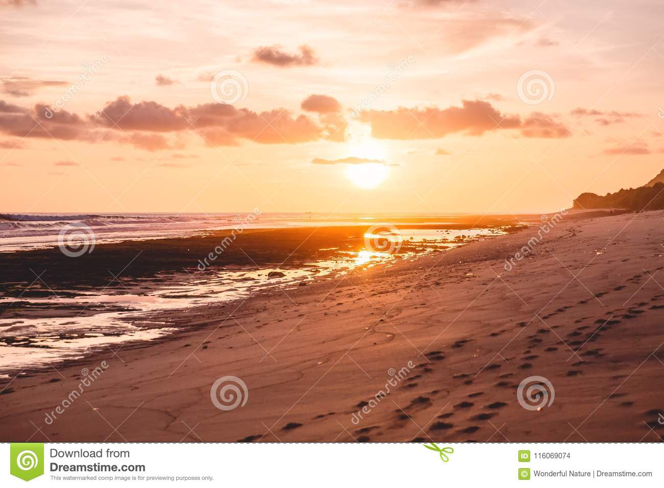 Tropical sandy beach and sunset or sunrise colors