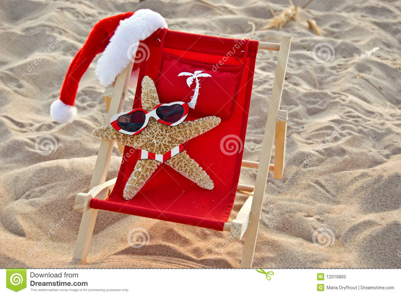 Santa starfish on a red beach chair royalty free stock photo image