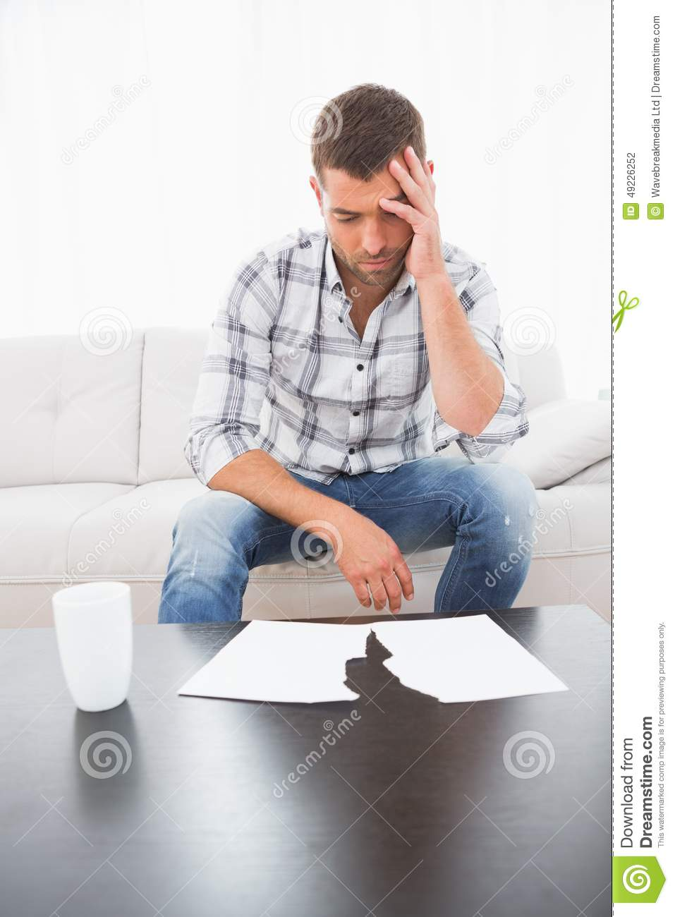 A troubled man looking papers