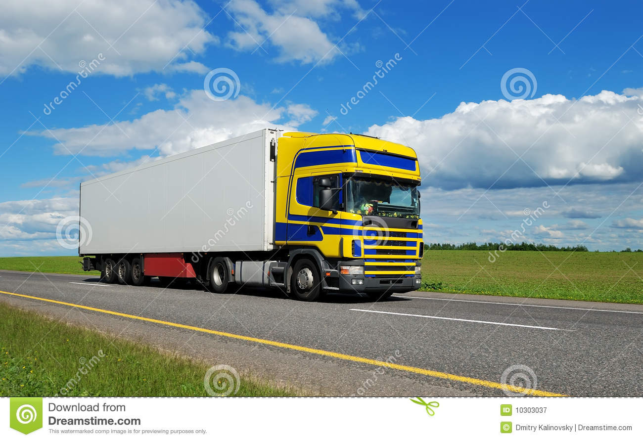 Royalty free stock photography truck with blue yellow cabin moving on