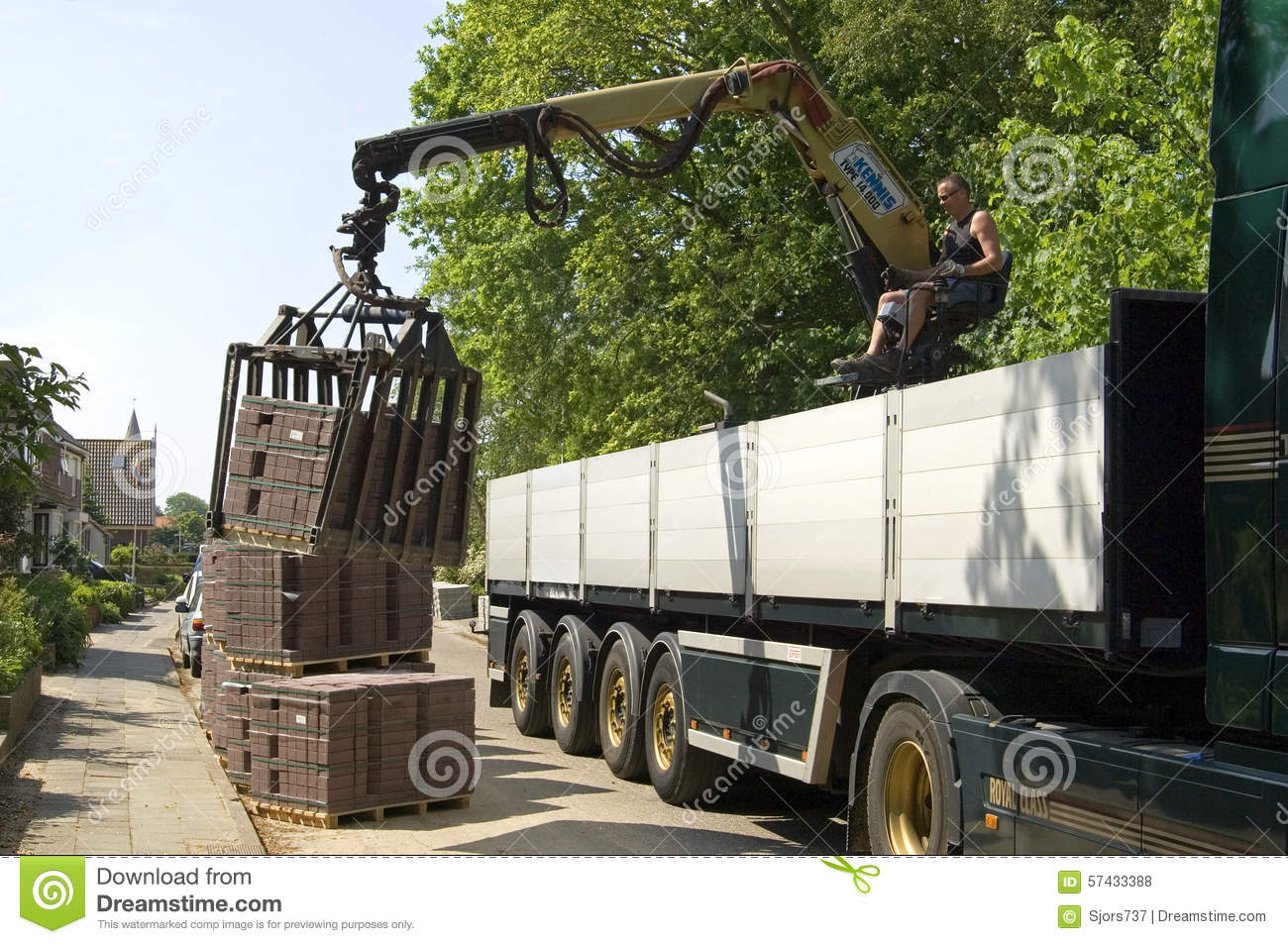truck driver road builder unload lorry paving stones editorial