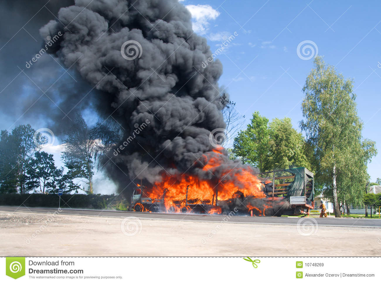 Truck In Fire With Black Smoke On The Road Royalty Free