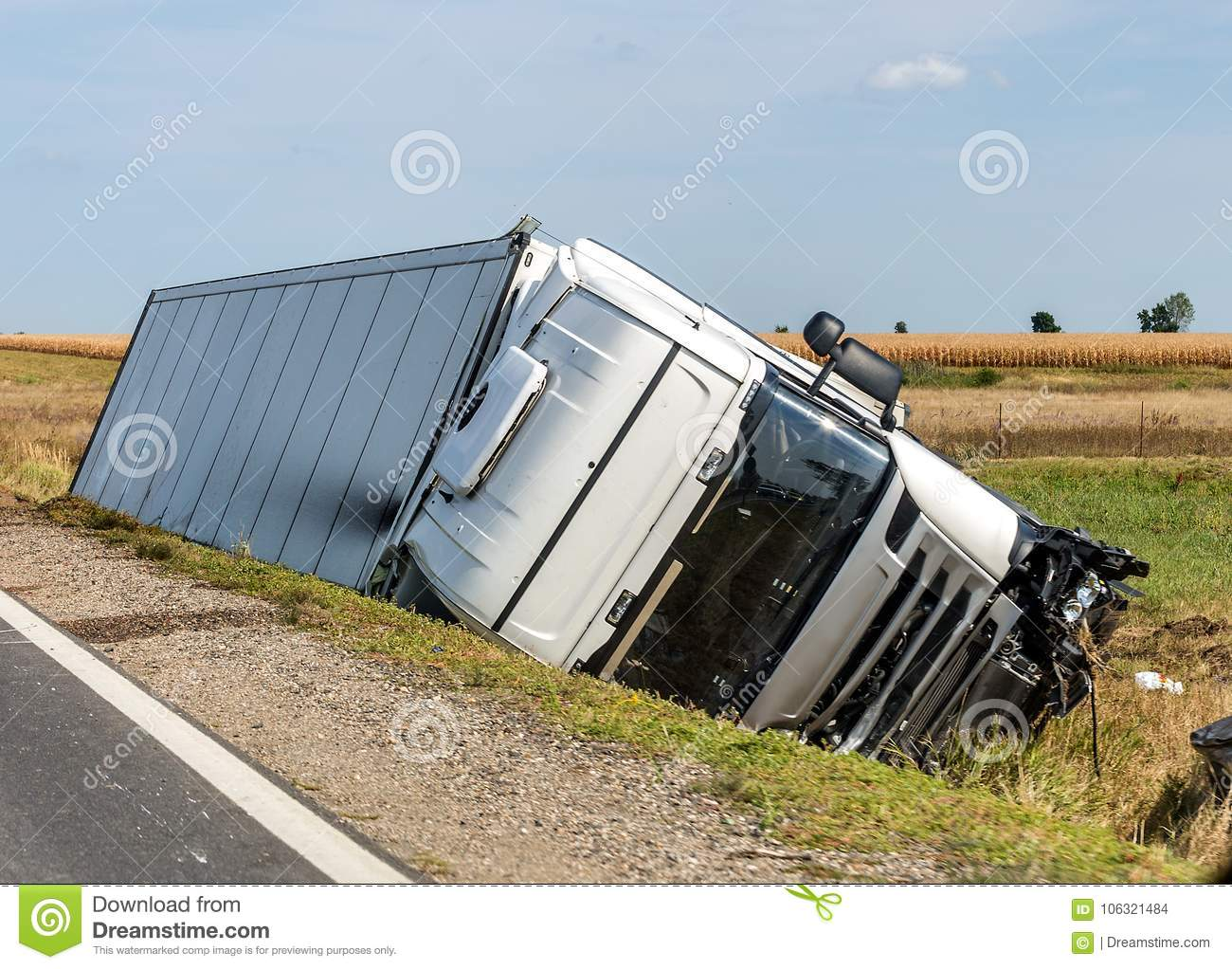 The Truck Lies In A Side Ditch After The Road Accident. Stock Photo ...