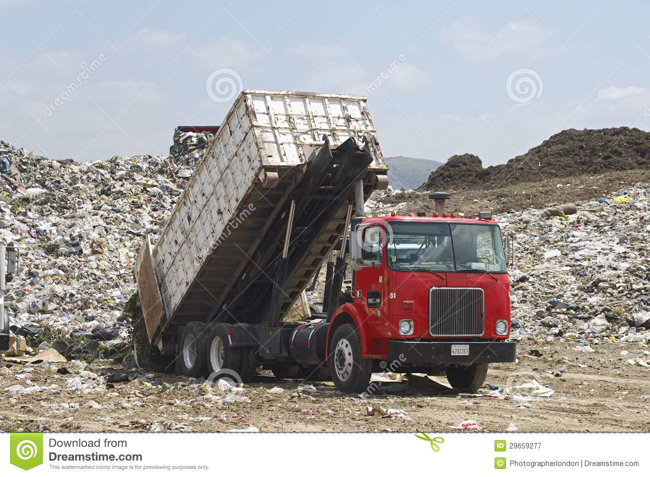 Truck Unloading Garbage At Site