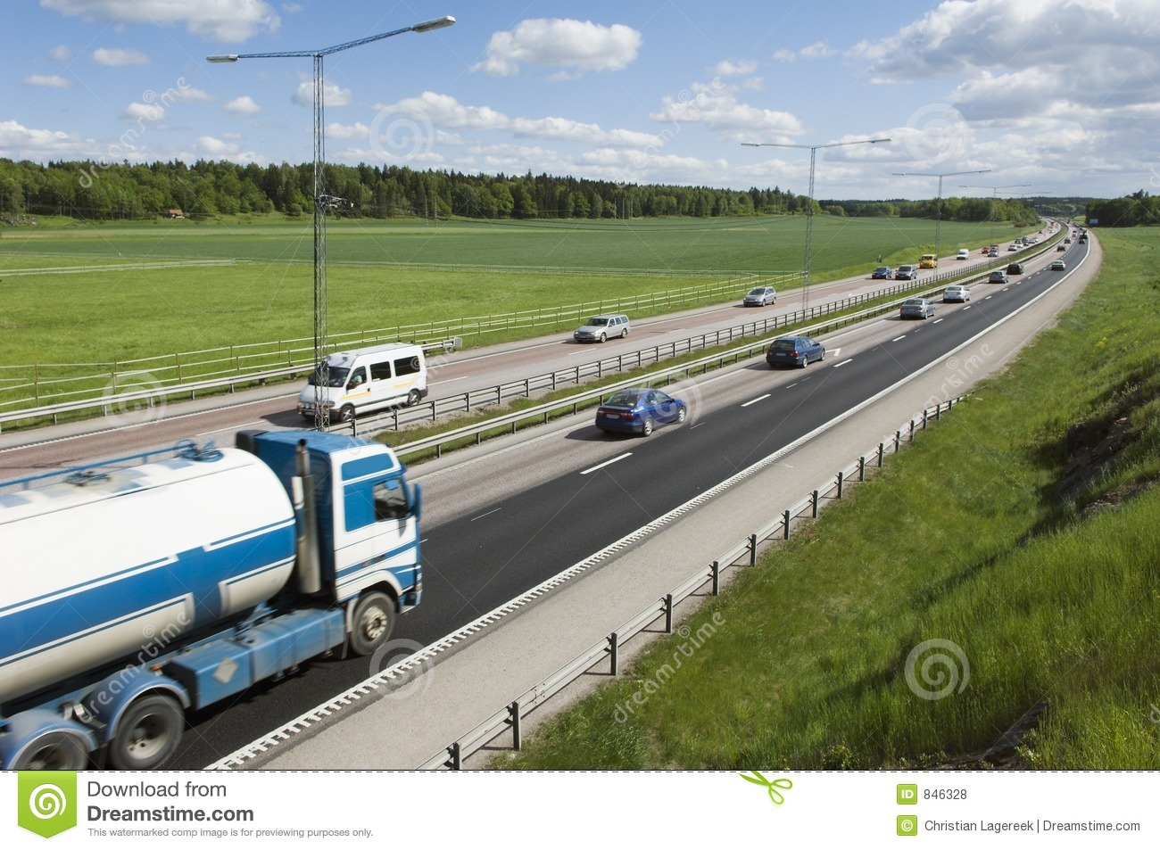 Trucks and cars on highway
