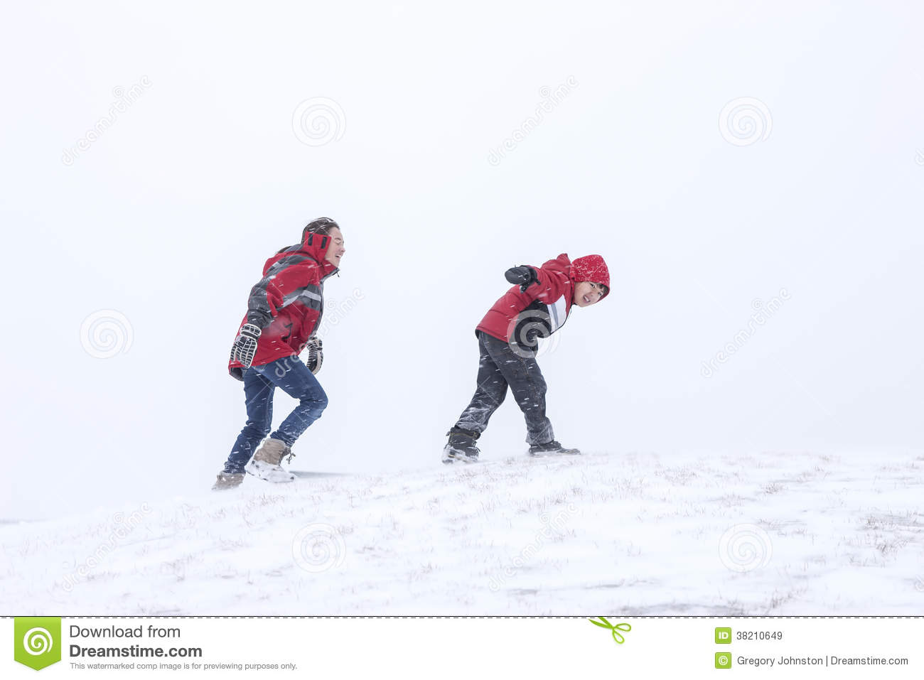 Young Man Trudging Through Snow With His Snowboard Royalty ...