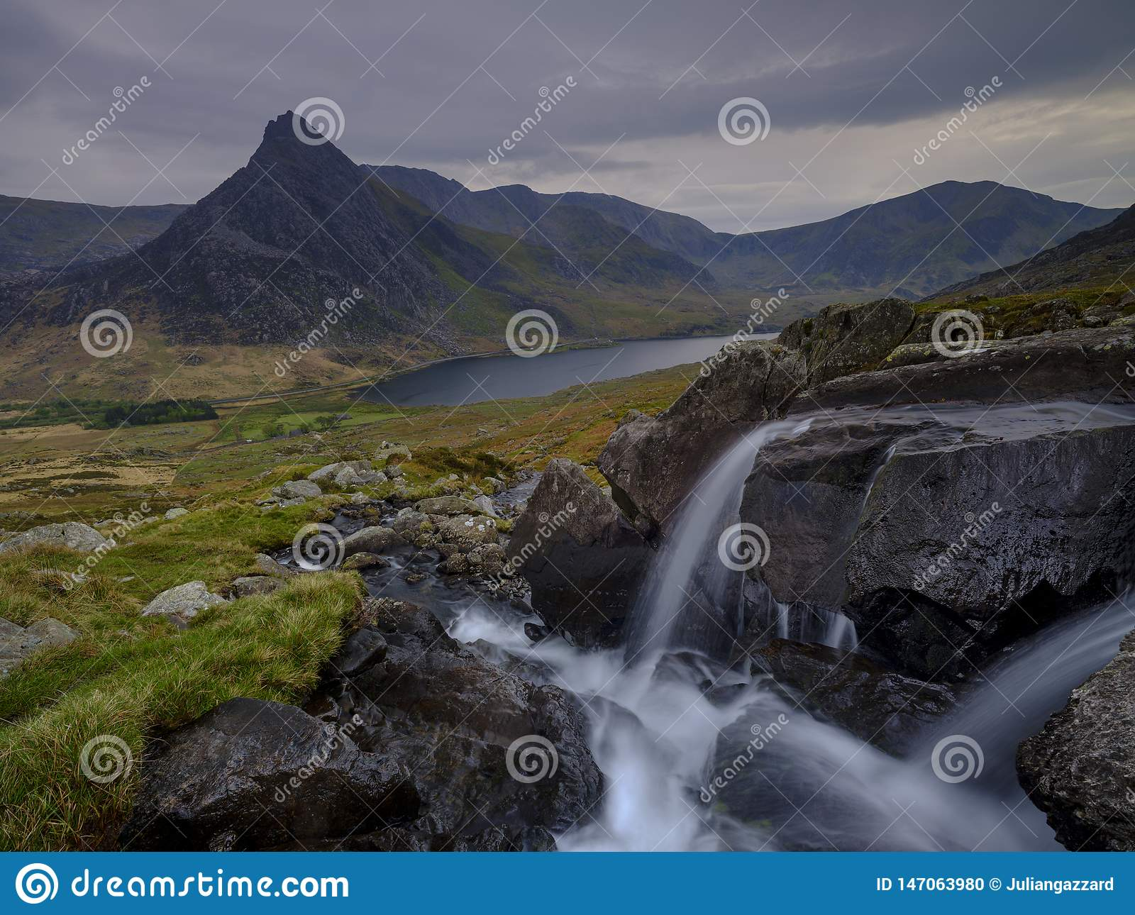 Tryfan in spring with the Afon Lloer in flow over the waterfalls, Wales