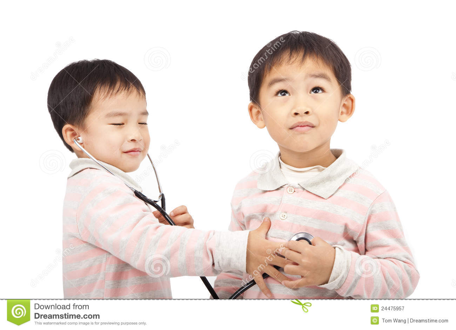 Ttwo boys using stethoscope Check