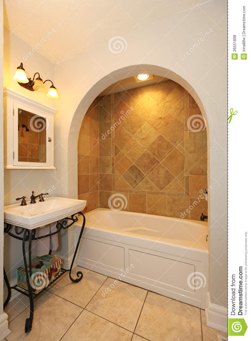 Tub With Arch And Stone Tiles Sink Bathroom Royalty Free