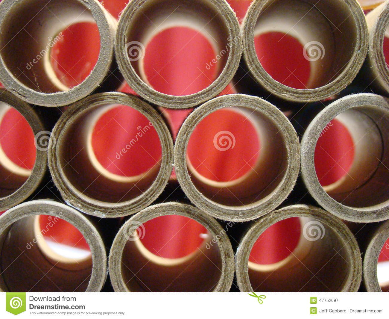 Tubes of cardboard with red background