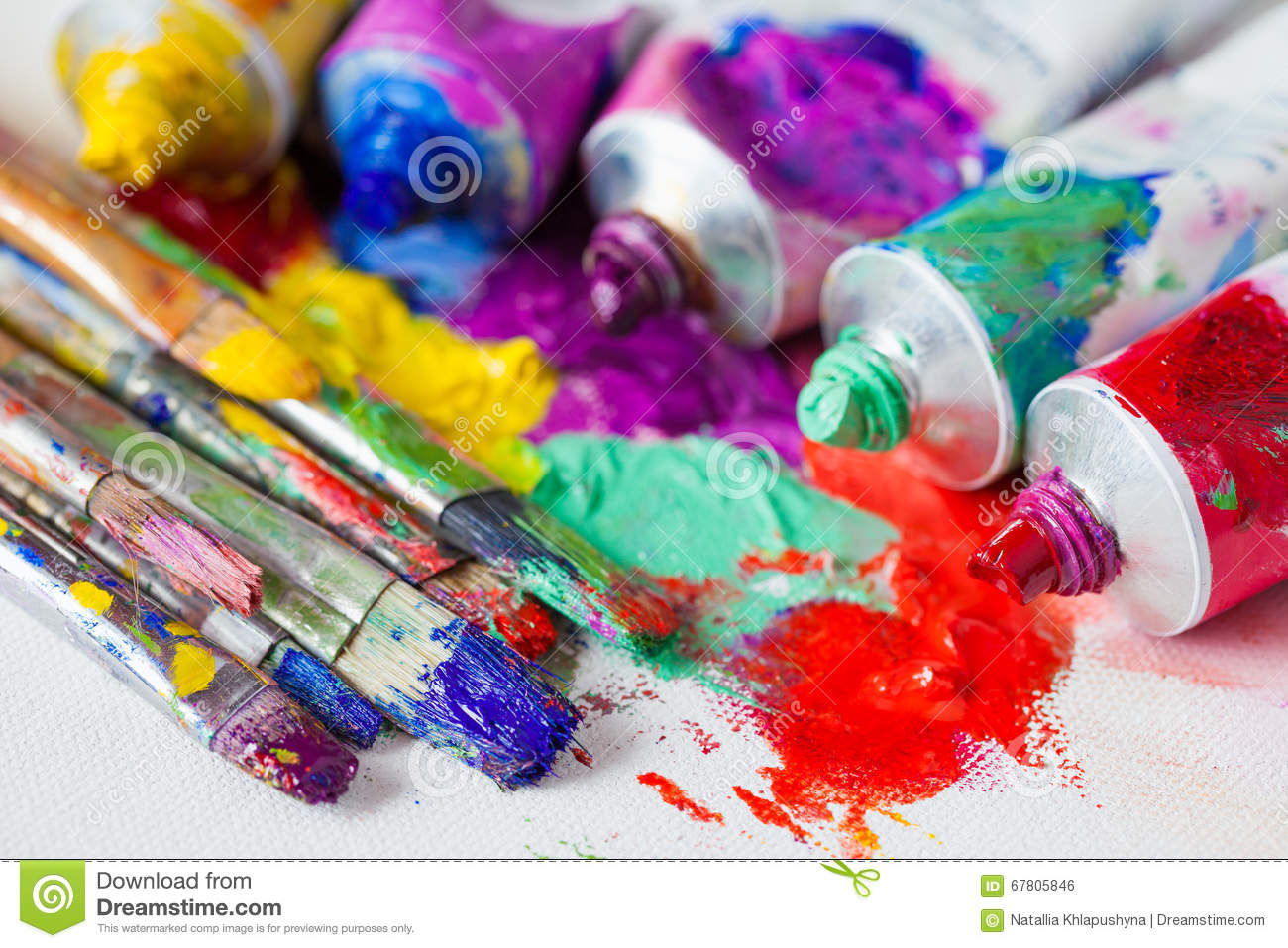 tubes of multicolor oil paint and artist paintbrushes on. Black Bedroom Furniture Sets. Home Design Ideas