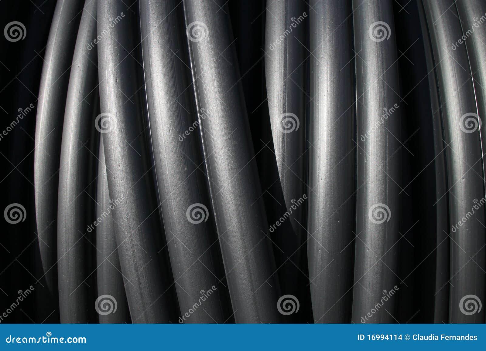 Tubi di plastica neri fotografia stock immagine di pila for Tipi di tubi di plastica