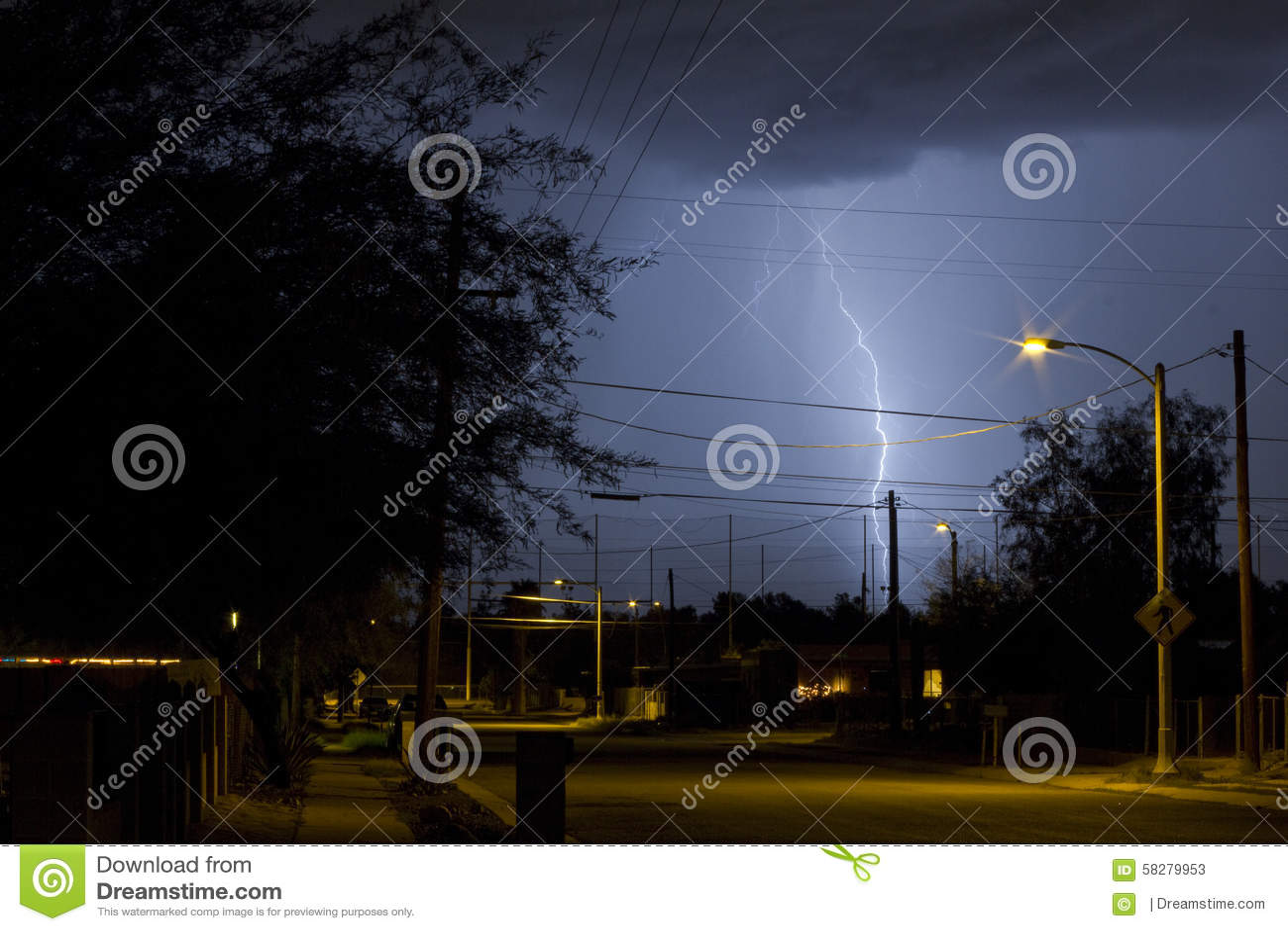 tucson arizona street at night during a lightning storm stock image