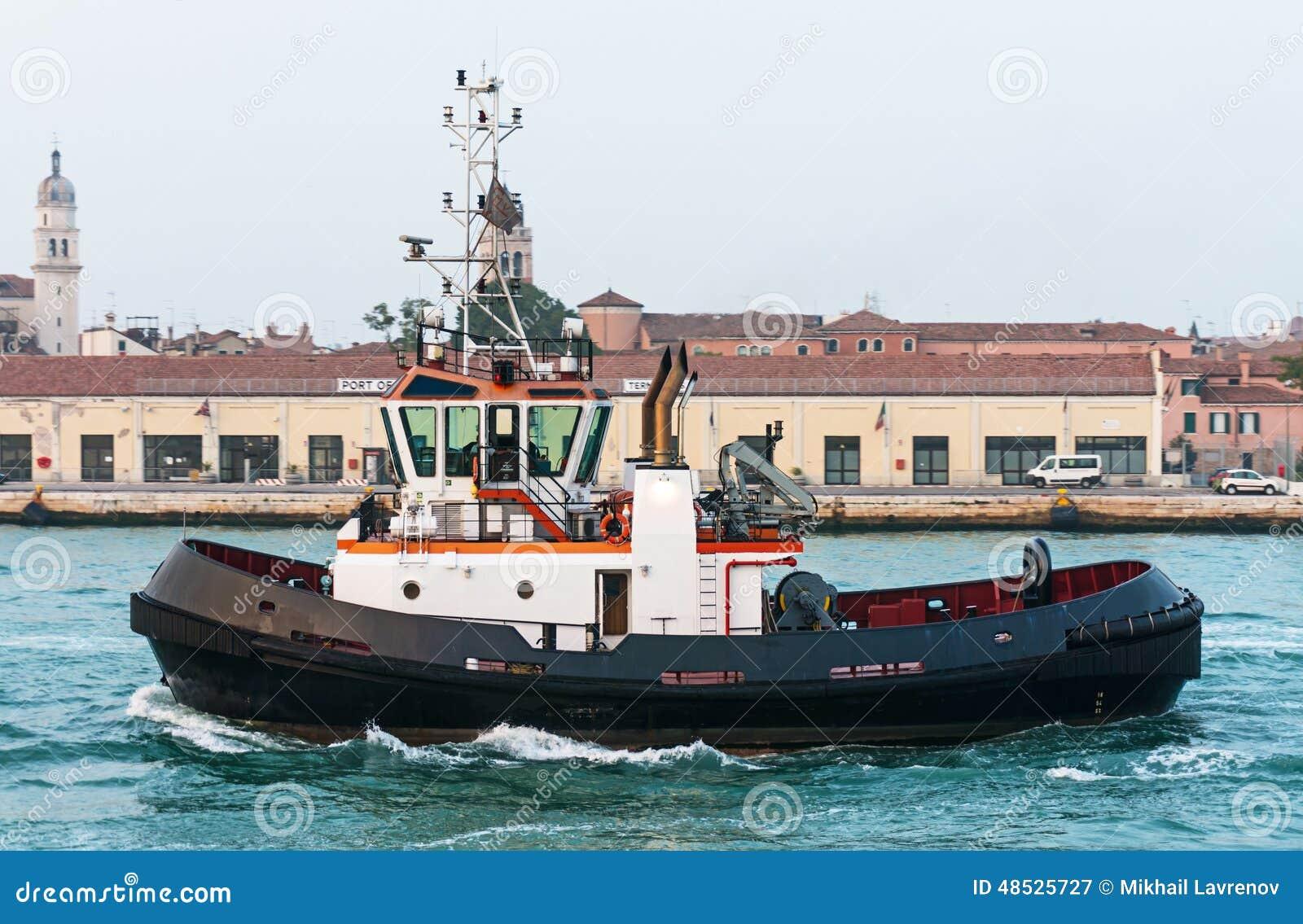 Tug boat in front of the old port in Venice