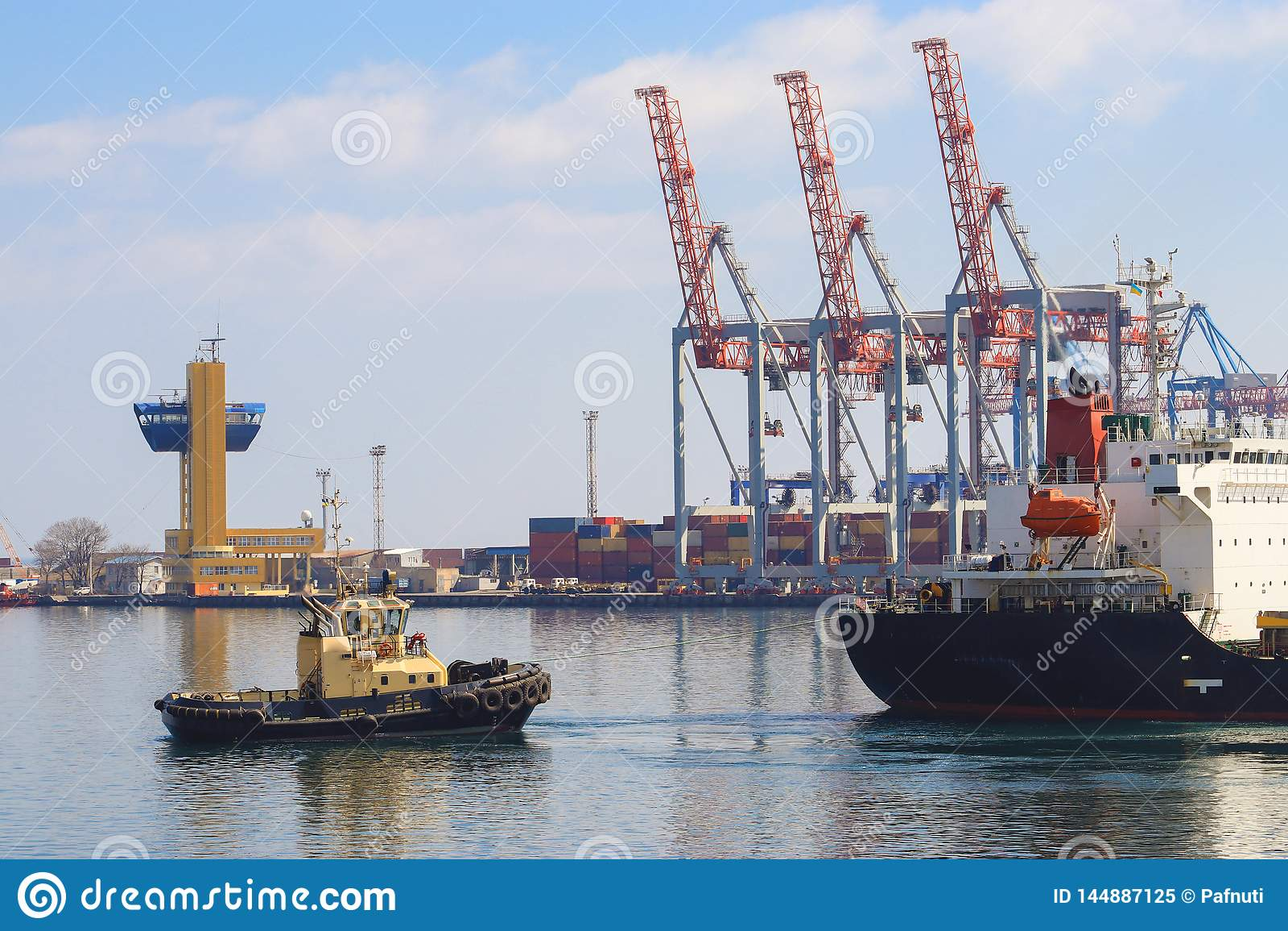 Tugboat assisting Cargo Ship maneuvered into the Port of Odessa, Ukraine.